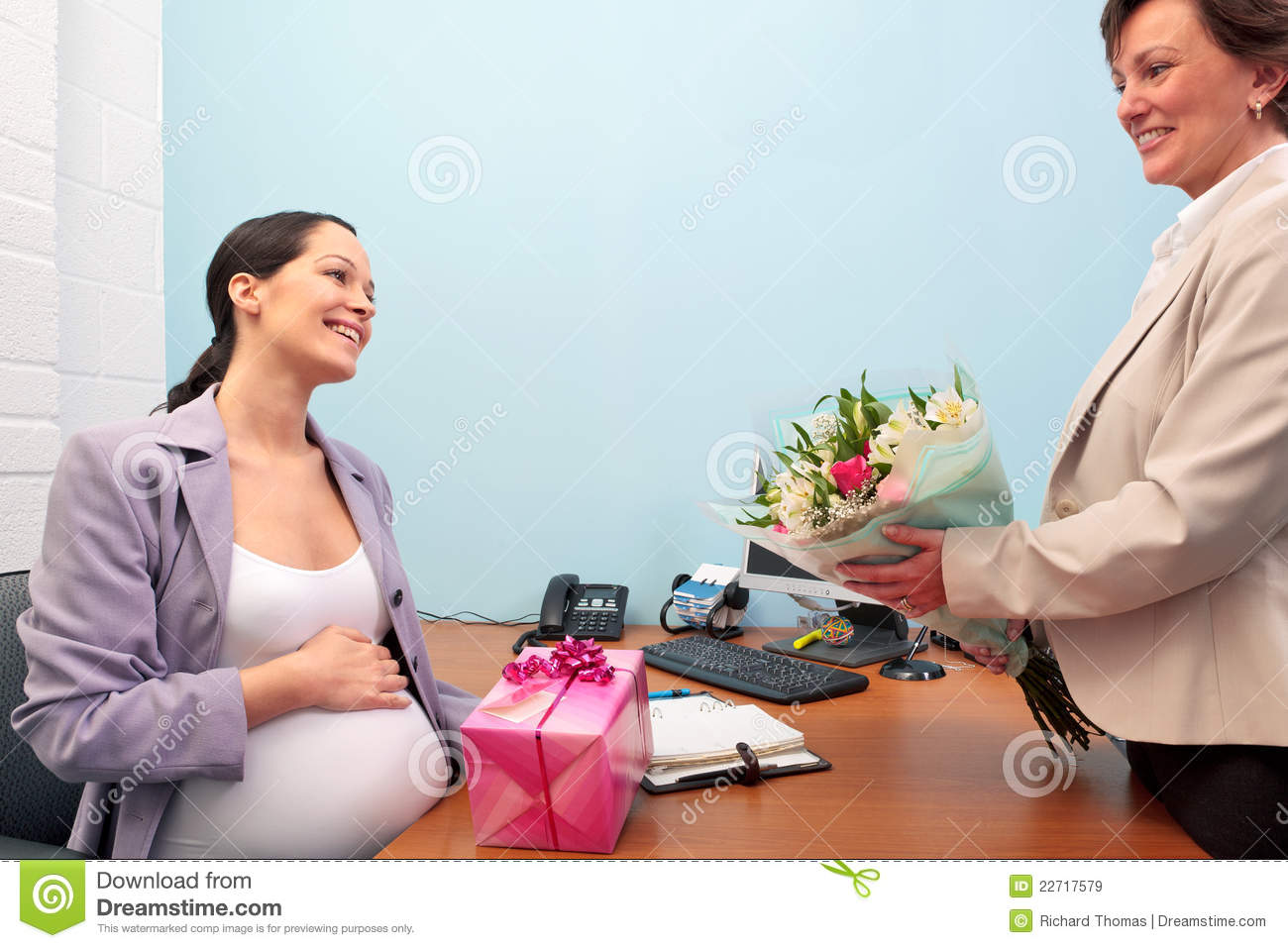 Pregnant office worker going on maternity leave.