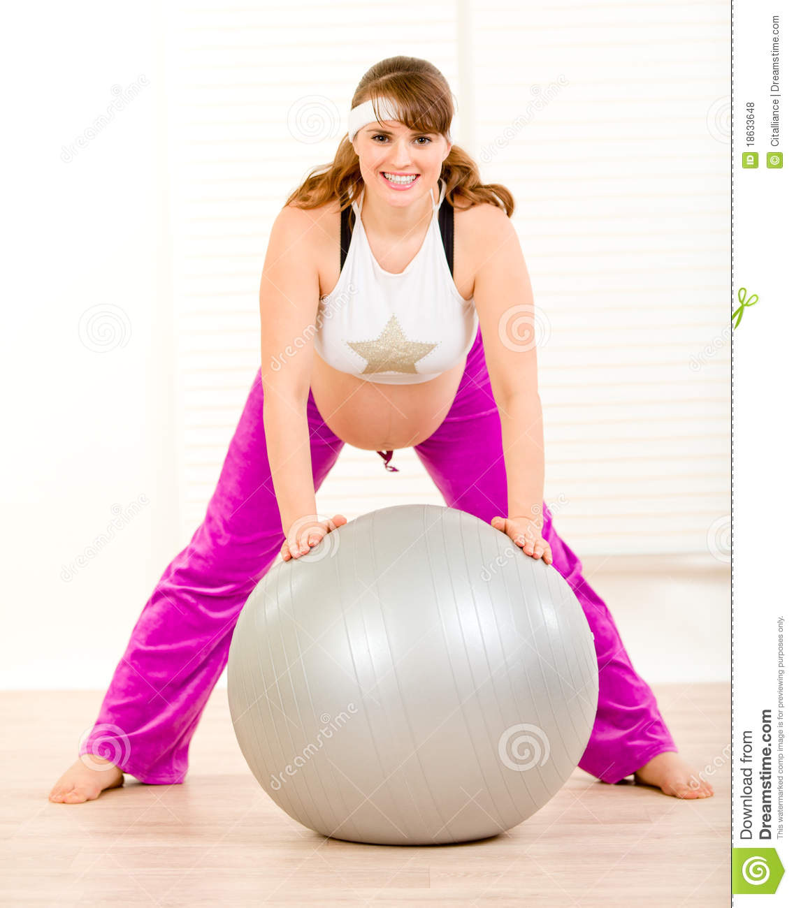Balance Ball Exercises For Pregnancy: Pregnant Woman Doing Exercises On Fitness Ball Royalty