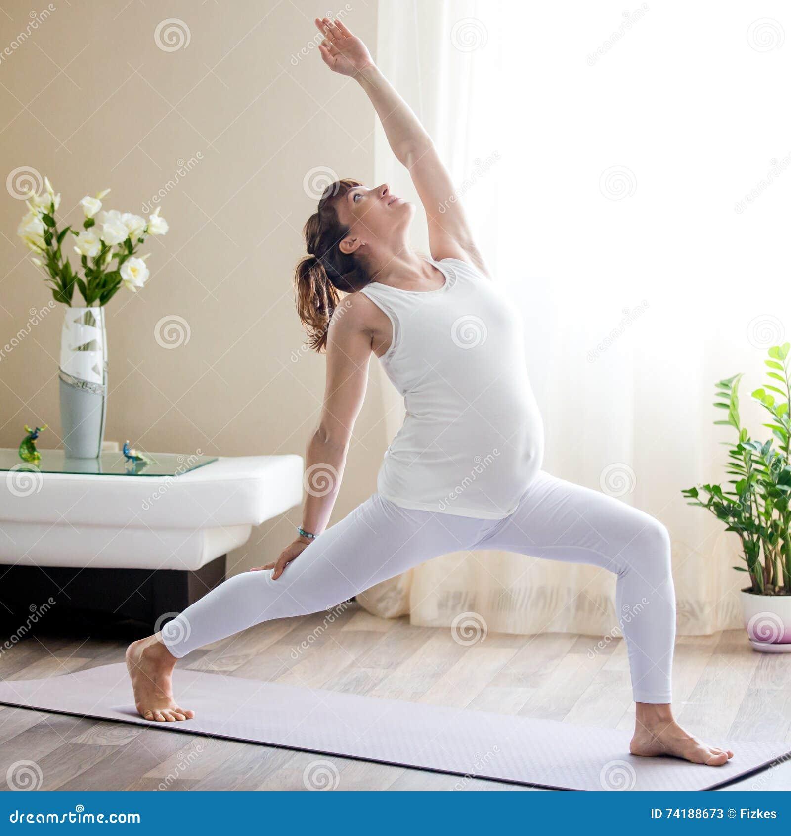 Pregnant Woman Doing Viparita Virabhadrasana Yoga Pose At ...