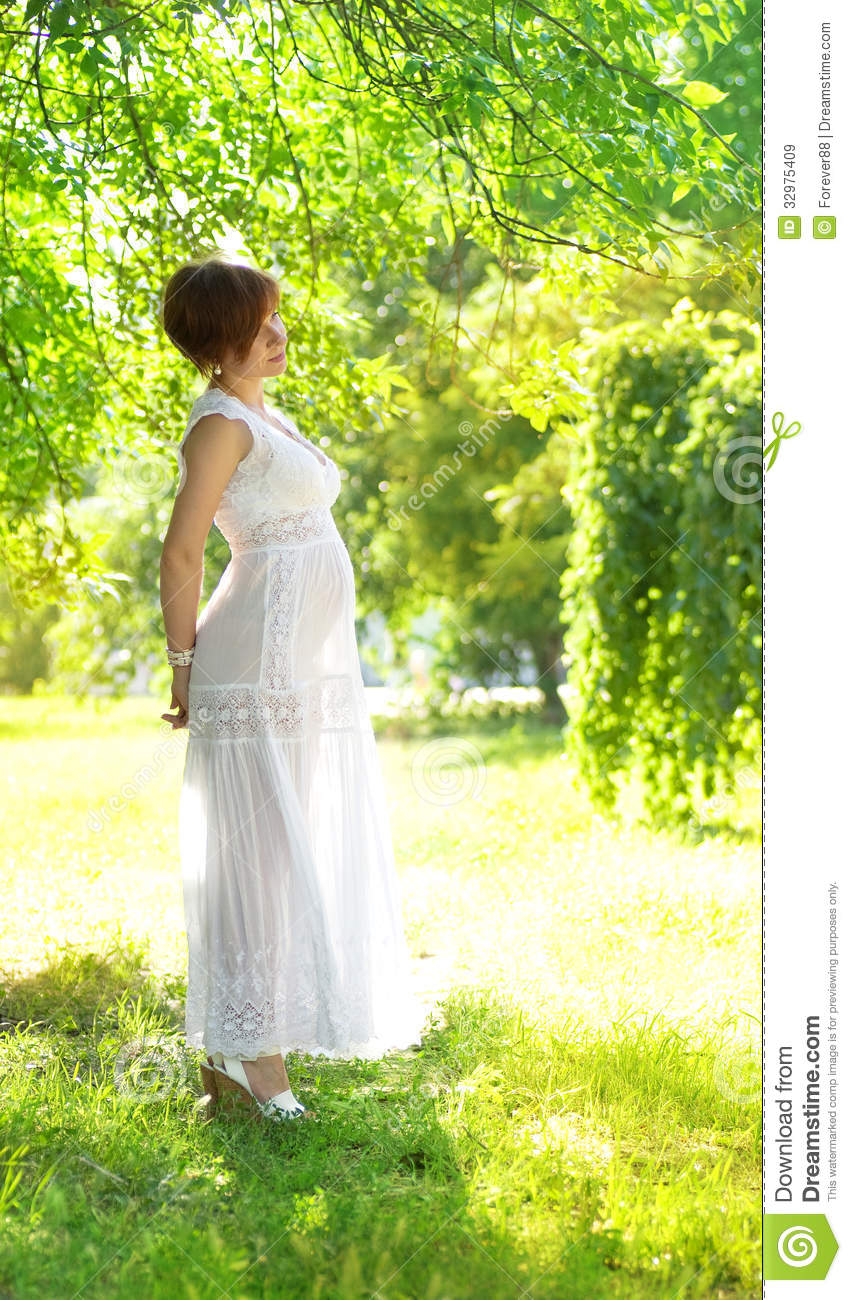 Pregnant woman in green garden royalty free stock images for Gardening while pregnant