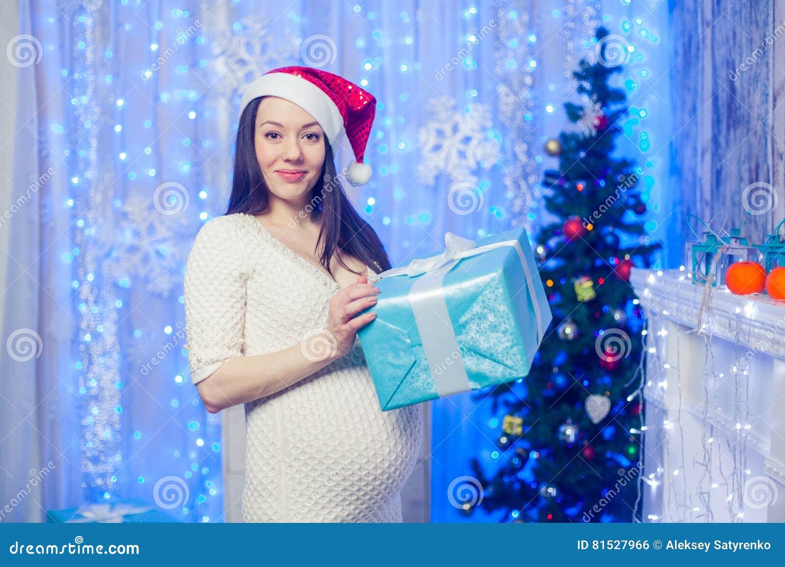 Beautiful Happy Pregnant Woman Near The Window. Stock