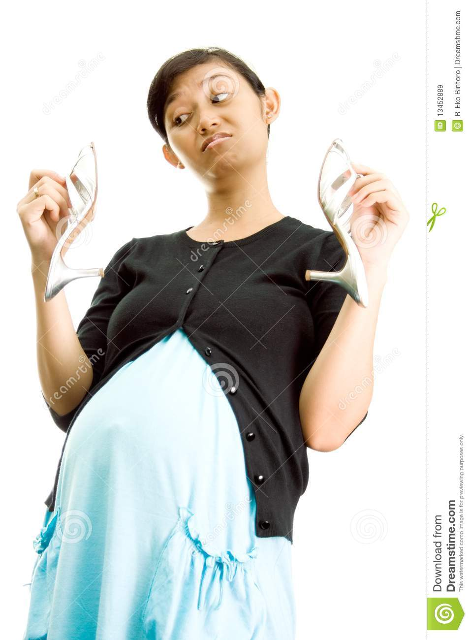 Pregnant Woman And High Heel Shoes Stock Image