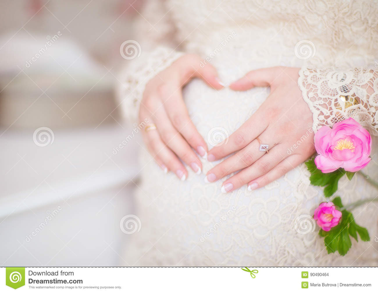 Pregnant Woman Holding Her Hands In A Heart Shape On Her Belly Stock ...