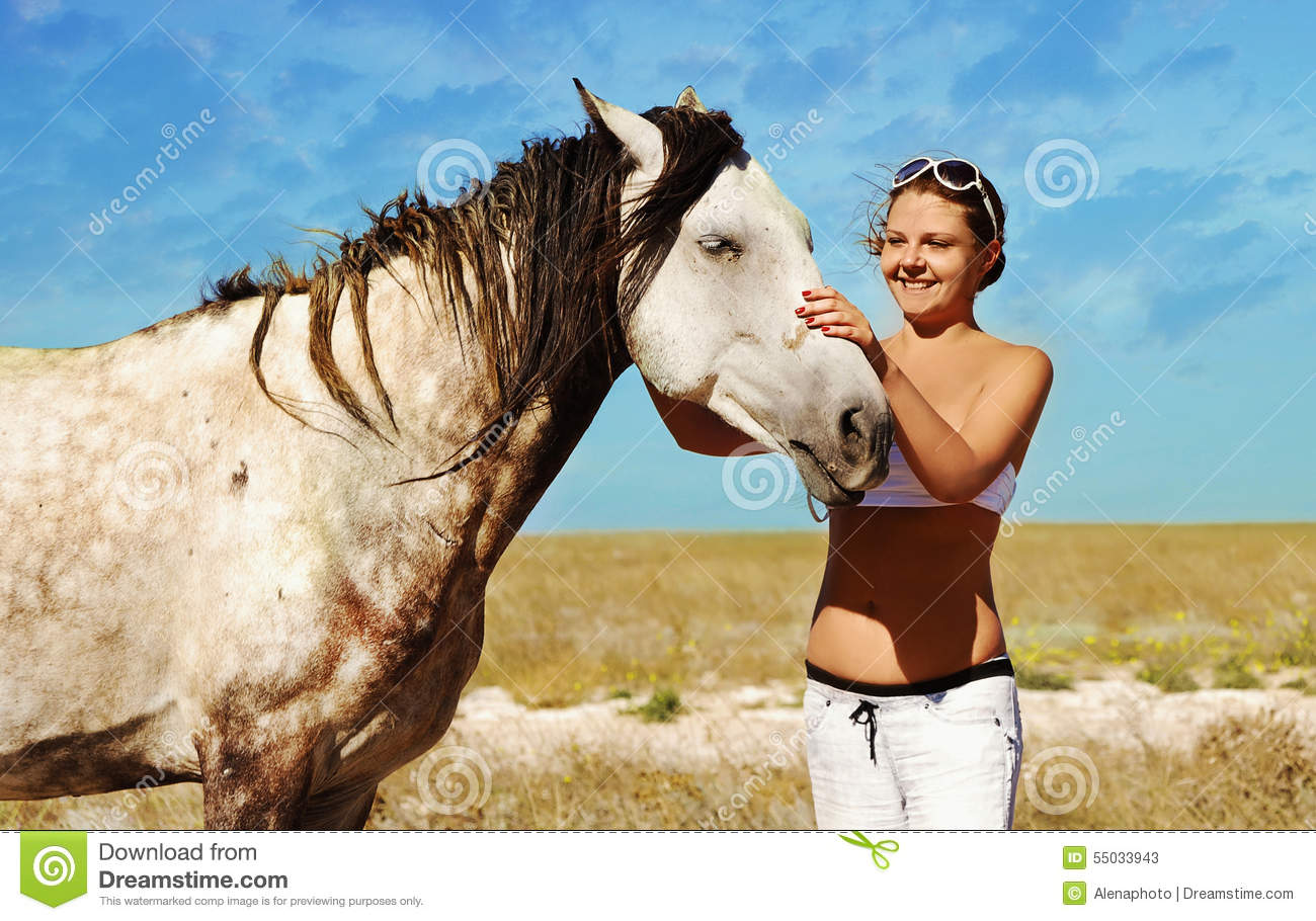 Pregnant woman and horse