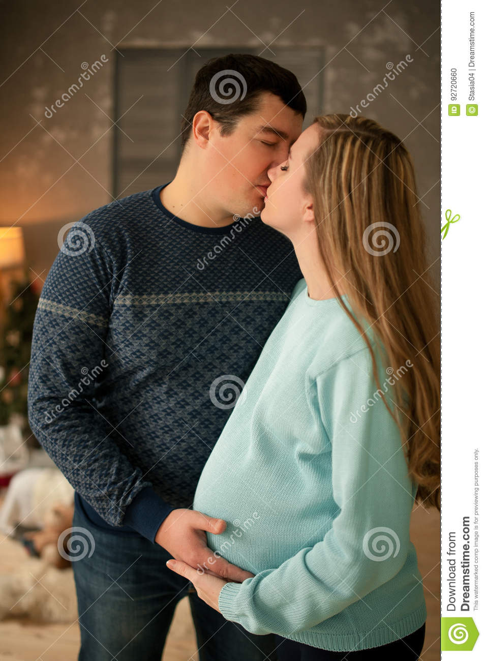 Pregnant woman and her husband kissing — Stock Photo ...