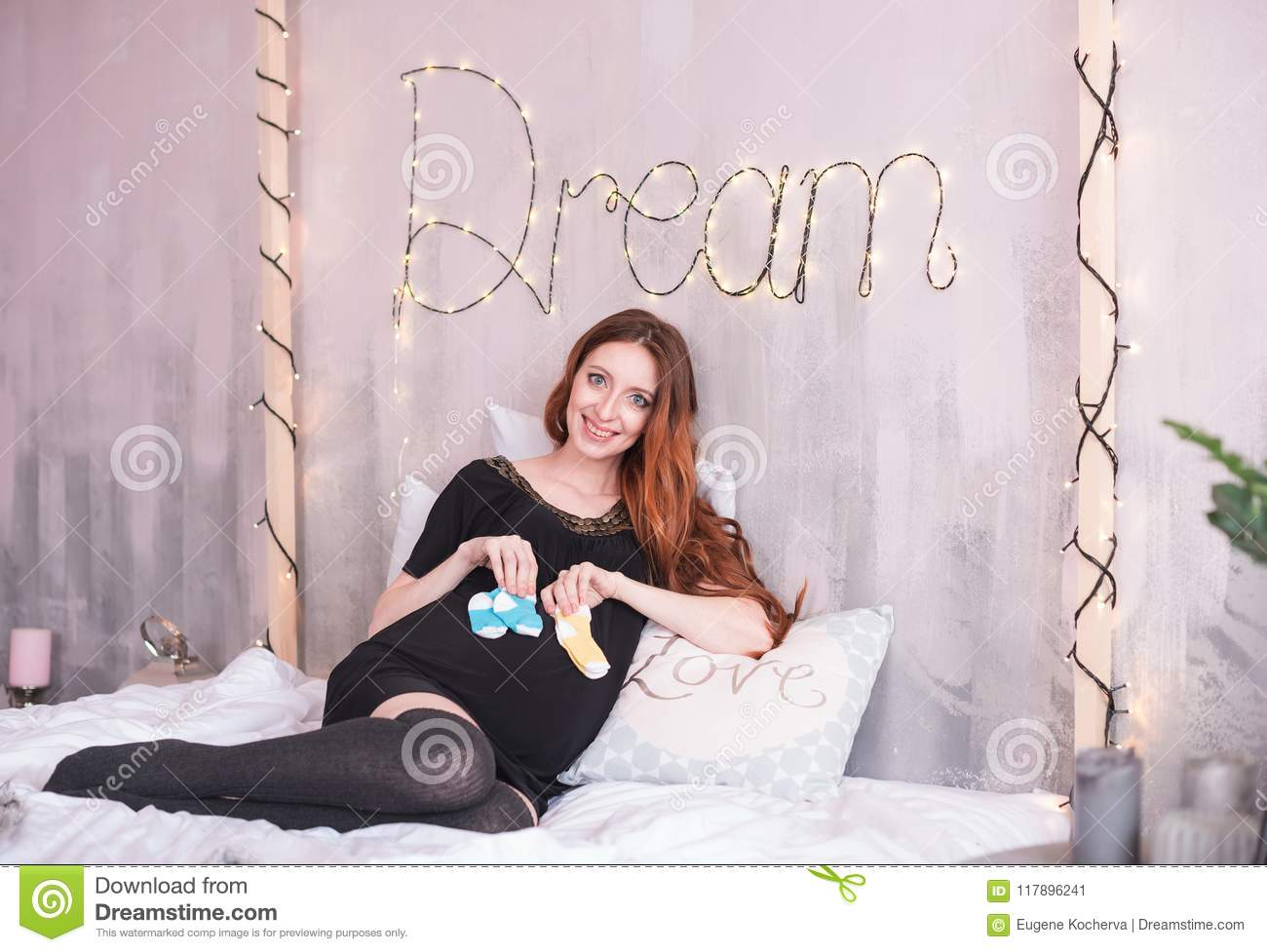 The Pregnant Woman With Long Red Hair In A Black Dress Stock Image