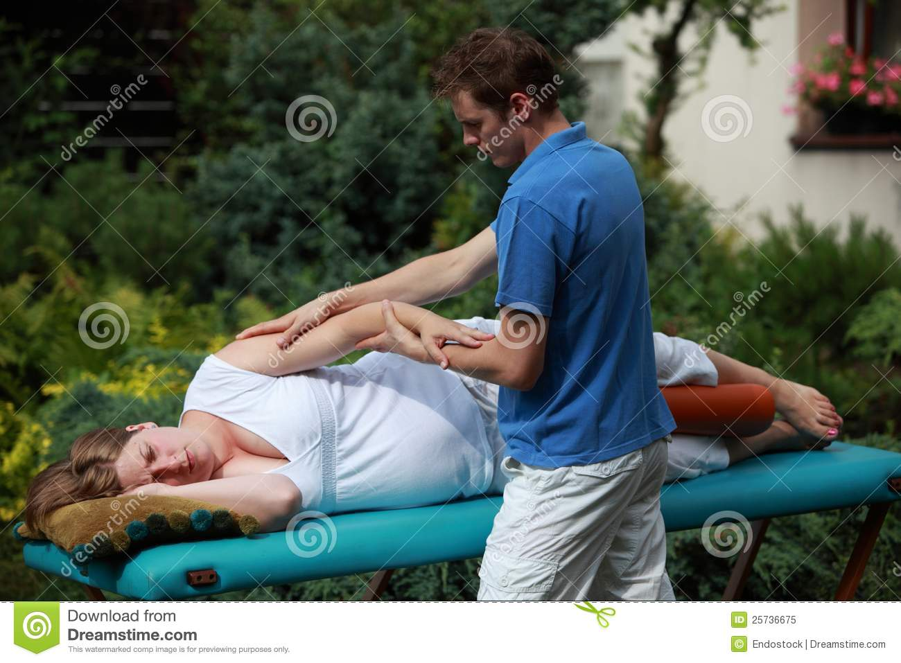 Pregnant woman massaging by therapist