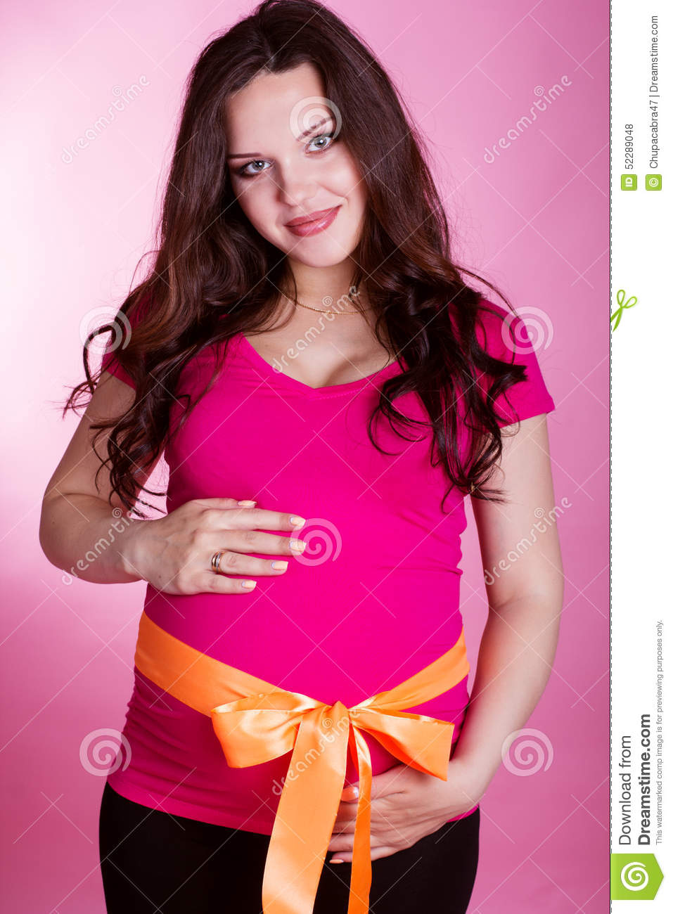 Pregnant woman with orange ribbon on belly