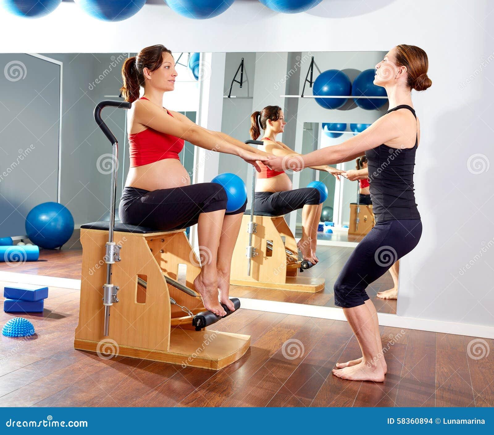 Woman Pilates Chair Exercises Fitness Stock Photo: Pregnant Woman Pilates Leg Pumps Exercise Wunda Stock