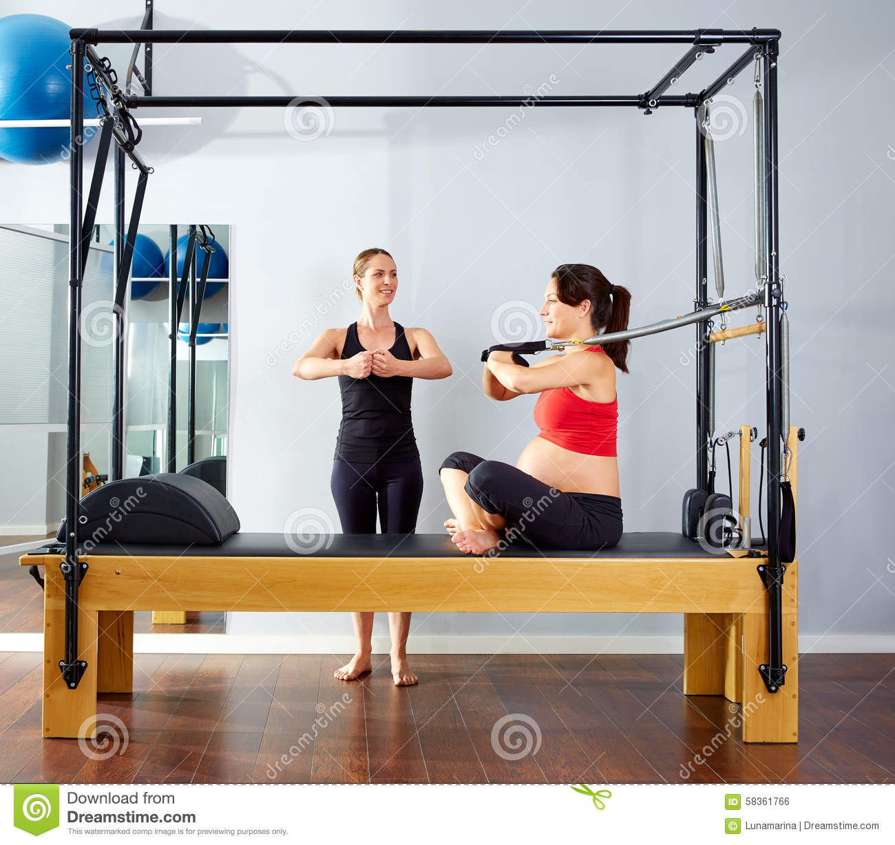 Pregnant Woman Pilates Reformer Arms Exercise Stock Photo