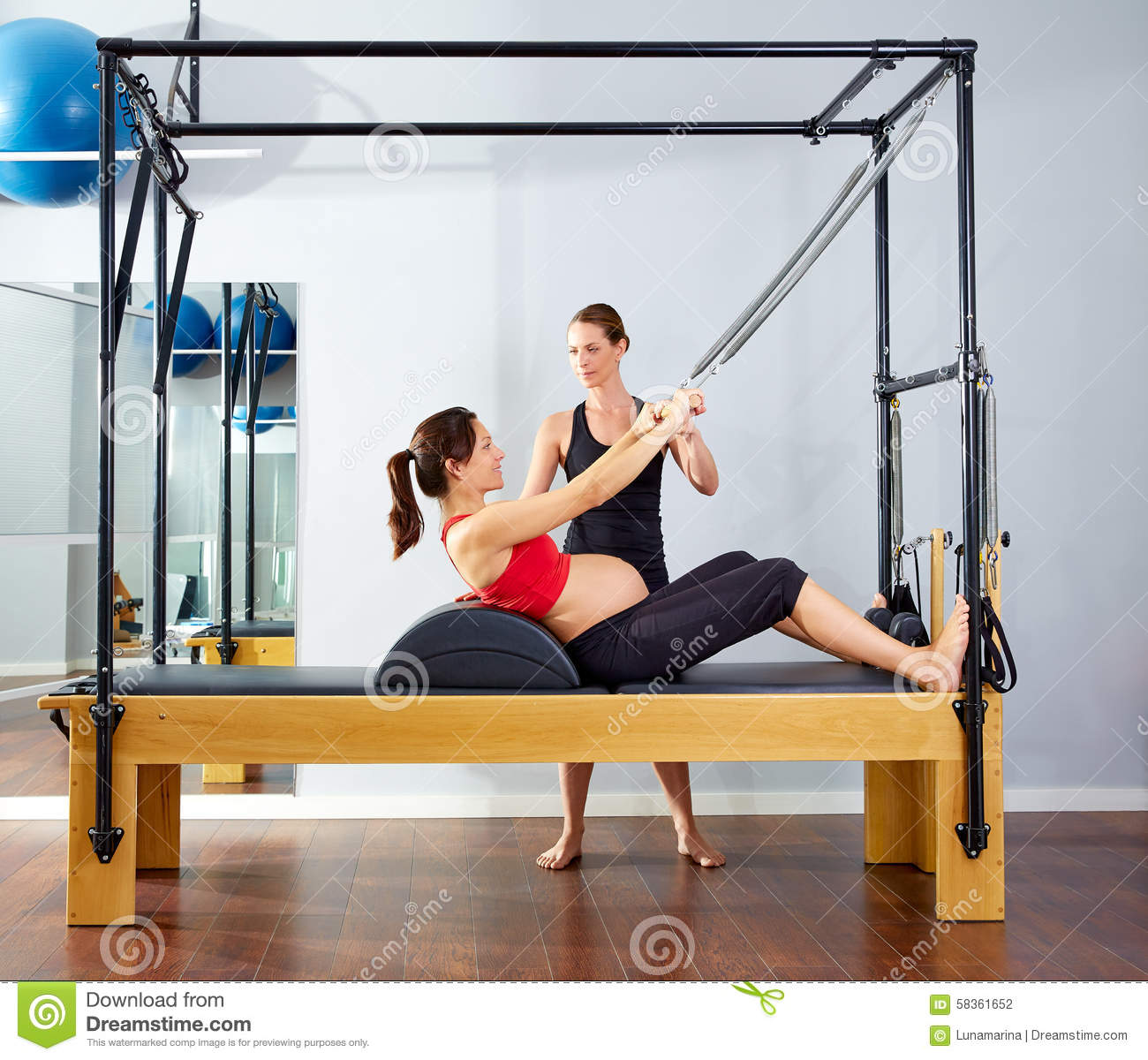 Woman Pilates Chair Exercises Fitness Stock Photo: Pregnant Woman Pilates Reformer Roll Up Exercise Stock