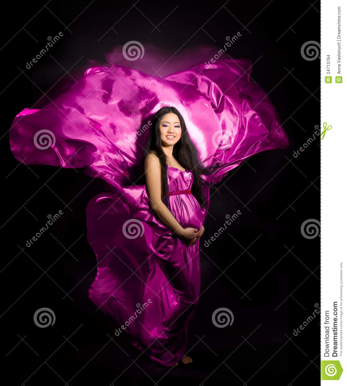 Pregnant woman in a pink dress