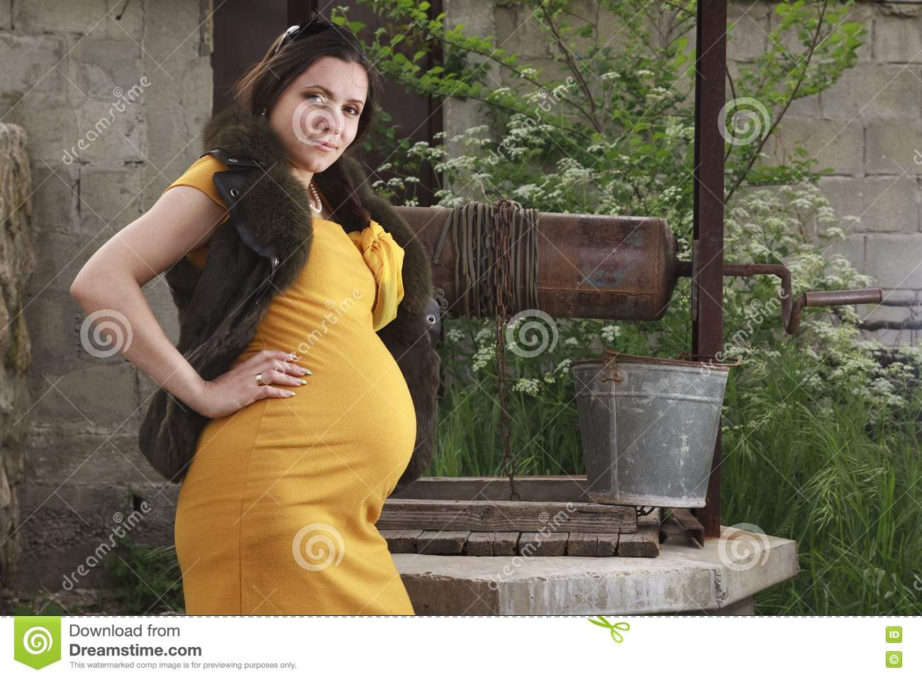 A pregnant woman is resting in the garden royalty free for Gardening while pregnant