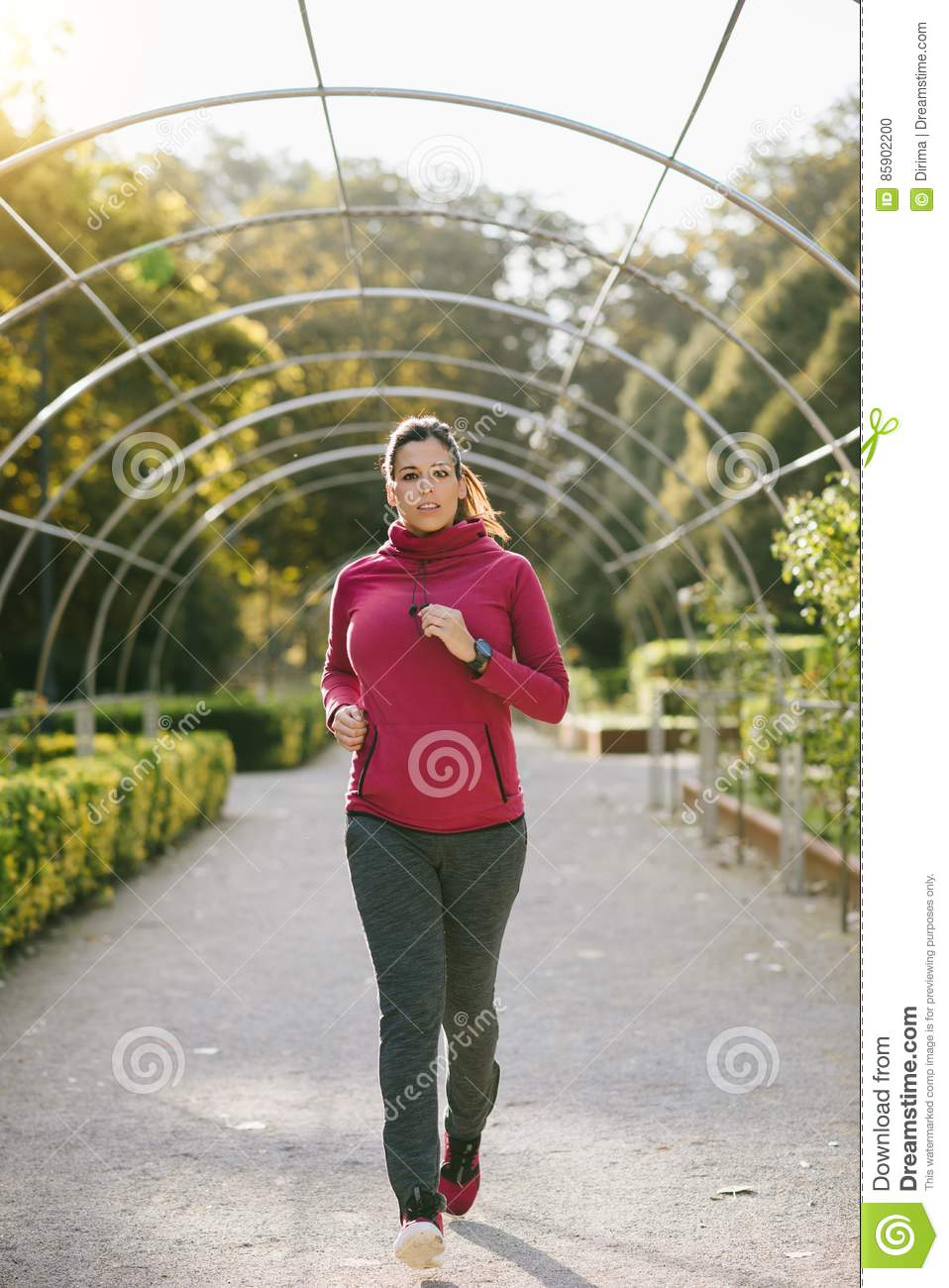 Pregnant woman running in autumn