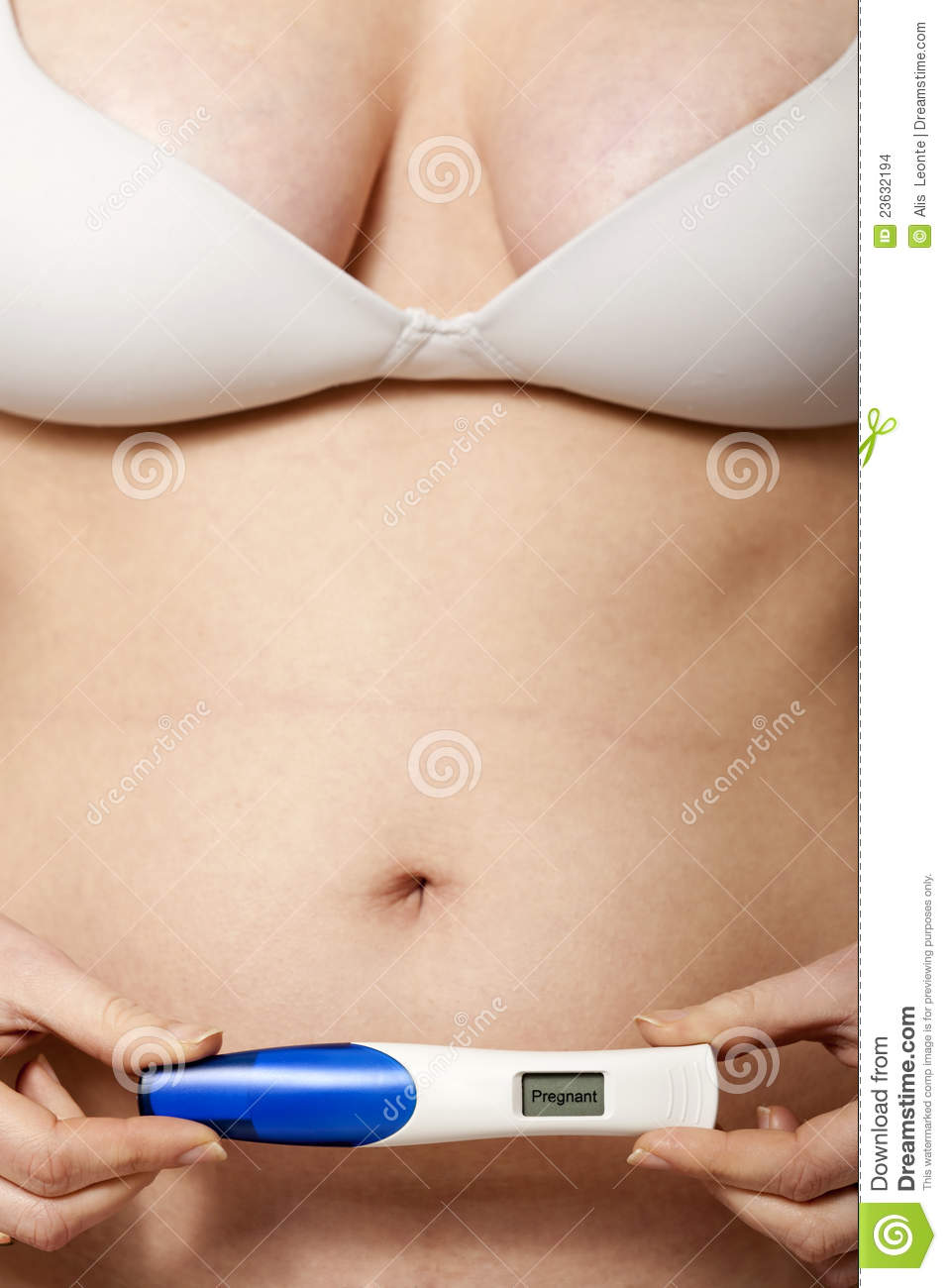 Pregnant woman showing positive pregnancy test