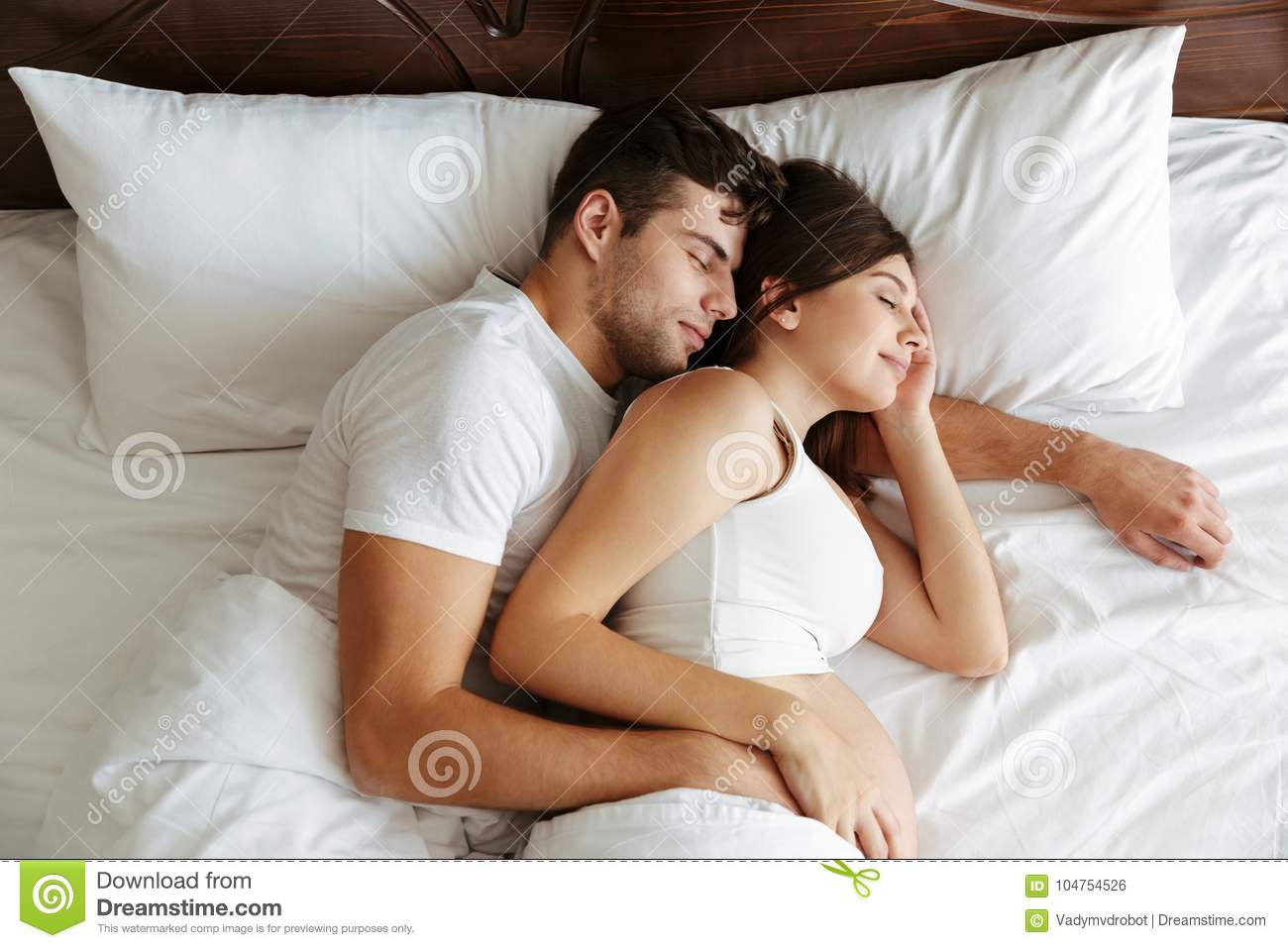 . Pregnant Woman Sleeping In Bed With Her Husband Stock Photo   Image