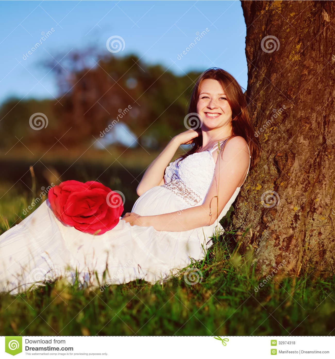 Pregnant woman in summer garden royalty free stock photos for Gardening while pregnant