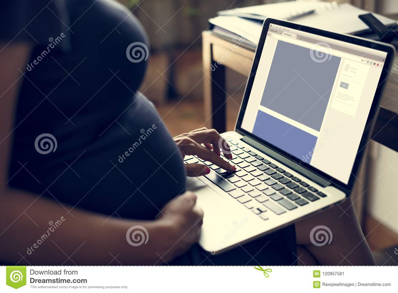 Pregnant woman is using computer laptop