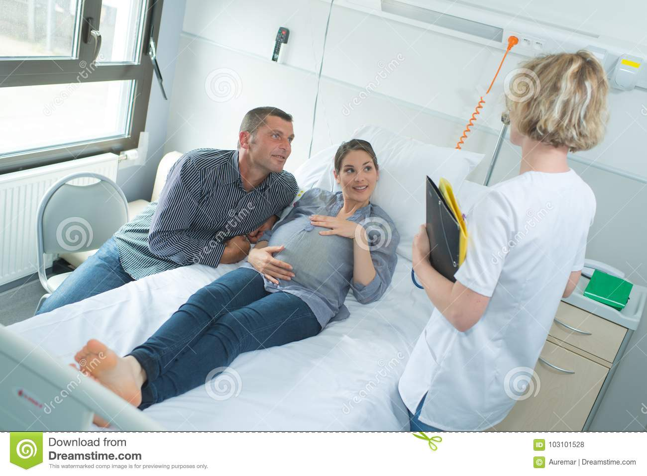 Pregnant Woman And Husband Having Doctor Visit Stock Photo ...