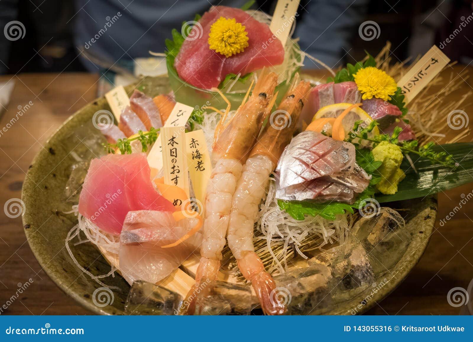 Premium sashimi, mix raw seafood on bowl at Japanese restaurant.