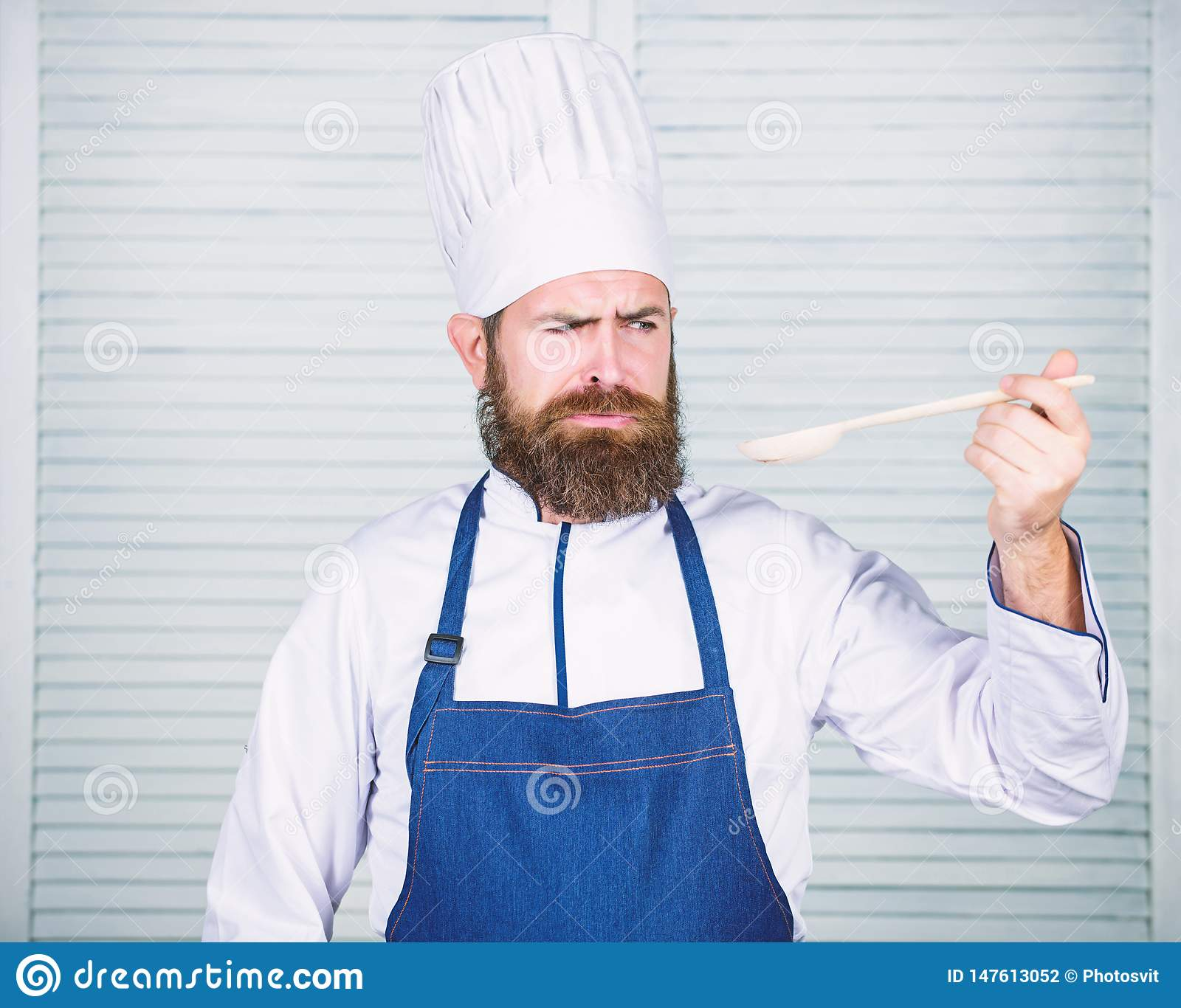 Preparation of food. Healthy food cooking. Bearded man cook in kitchen, culinary. Chef man in hat. Secret taste recipe