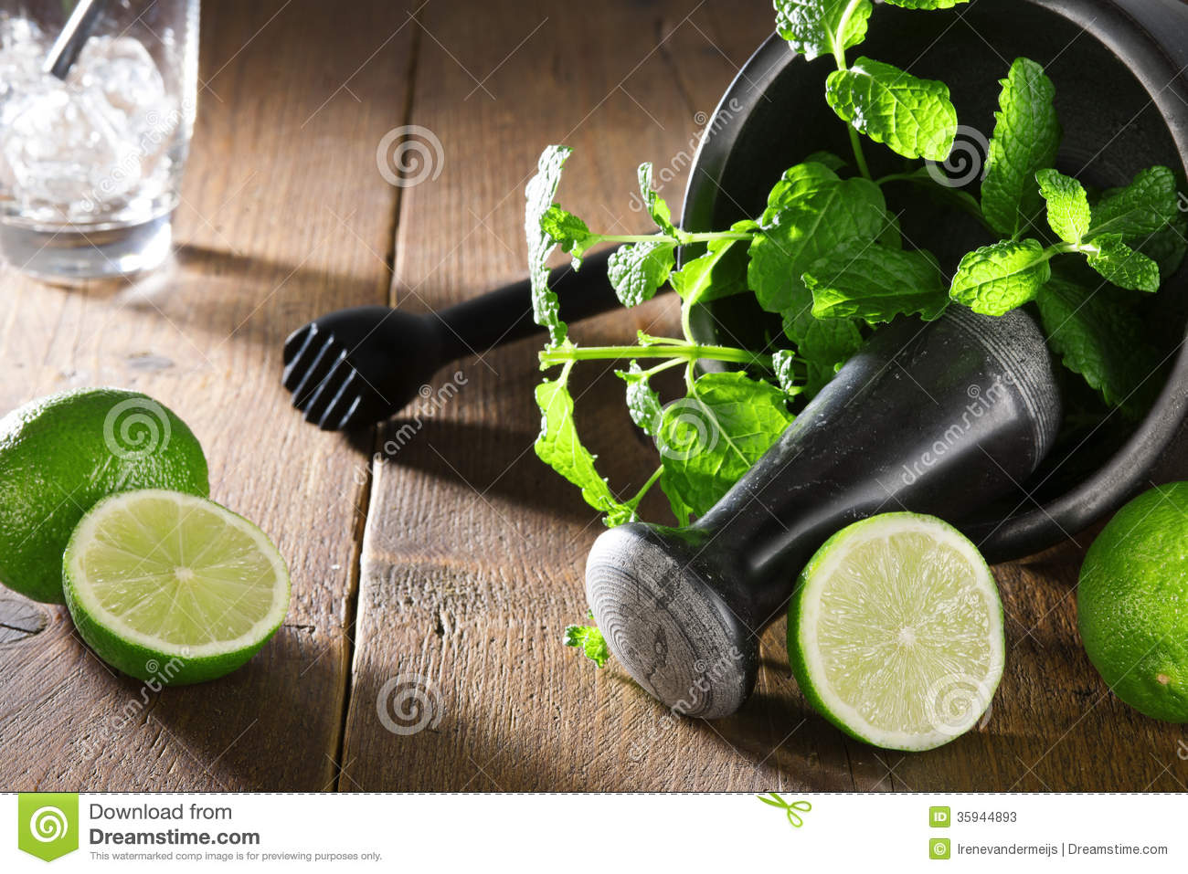 preparation for mojito with ingredients on wooden table. Black Bedroom Furniture Sets. Home Design Ideas