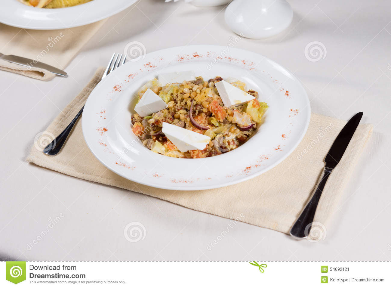 Simple restaurant table setting - Prepared Dish At Place Setting On Restaurant Table