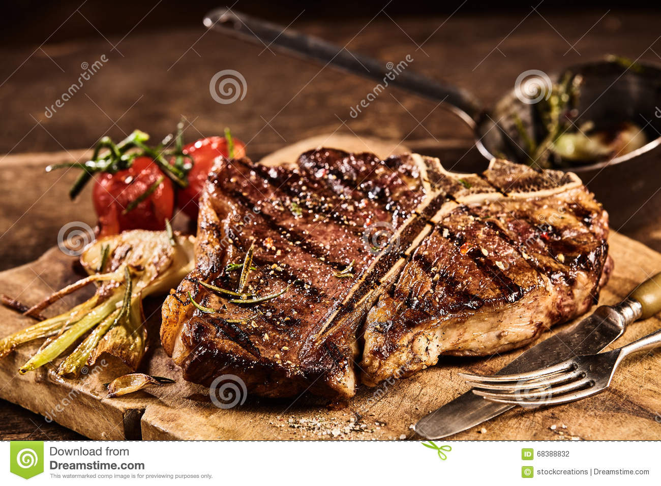 Prepared Grilled Porterhouse Steak With Fork And Knife Stock Photo ...