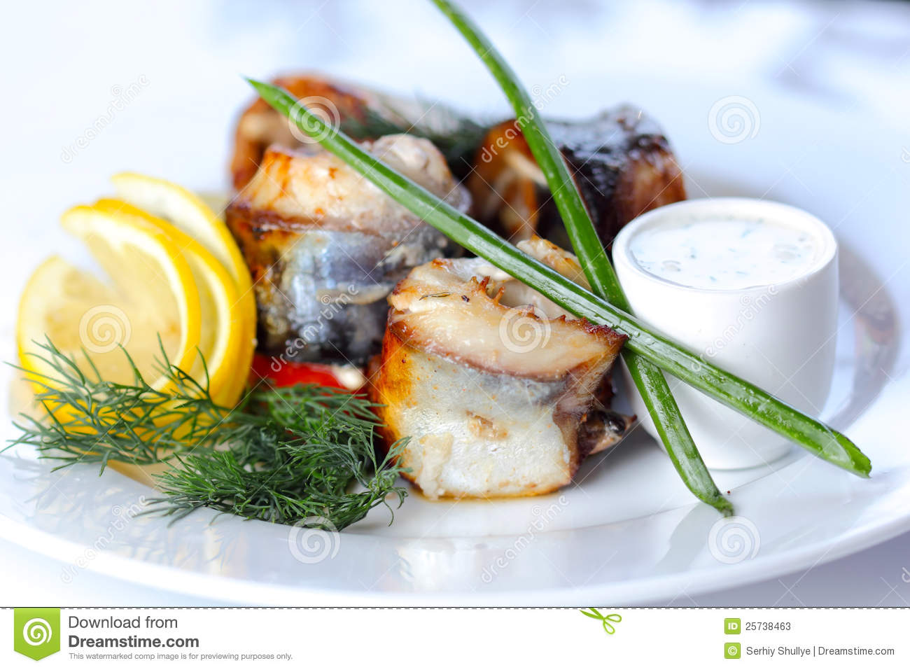 Prepared sea fish portions with greens