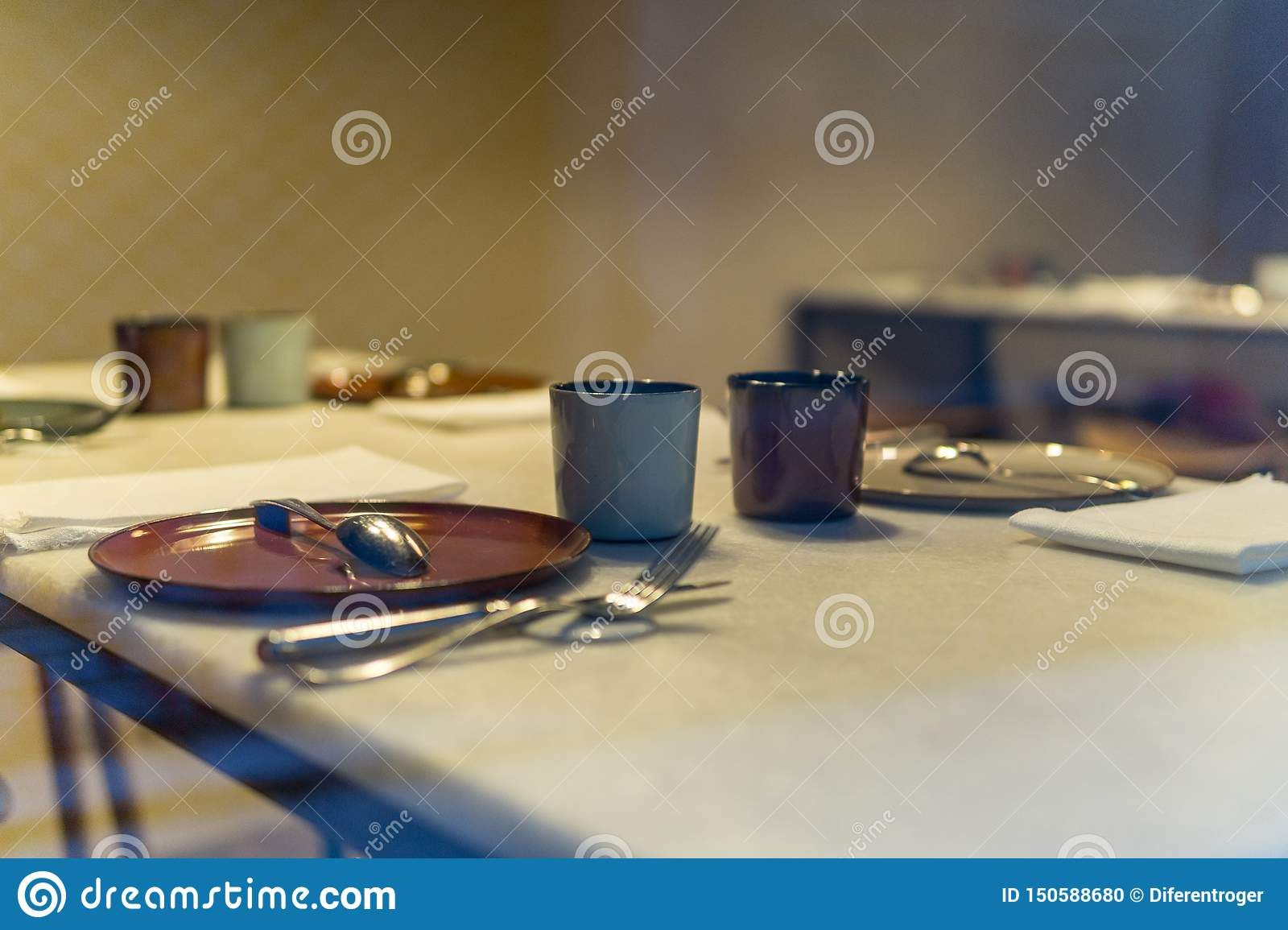 Prepared table without people to eat with warm background in restaurant