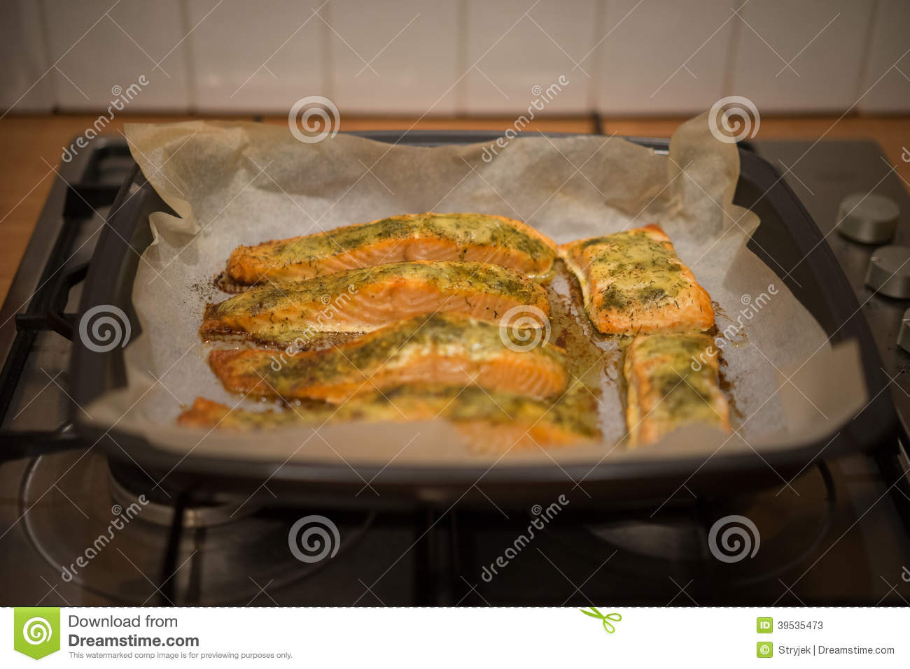 Preparing baked fish in a roasting pan stock photo image for Fish fillet in oven