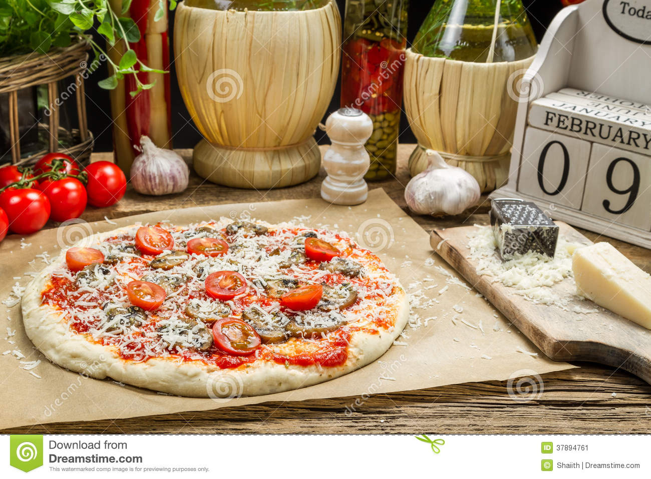 Preparing Homemade Pizza With Fresh Ingredients Stock ...