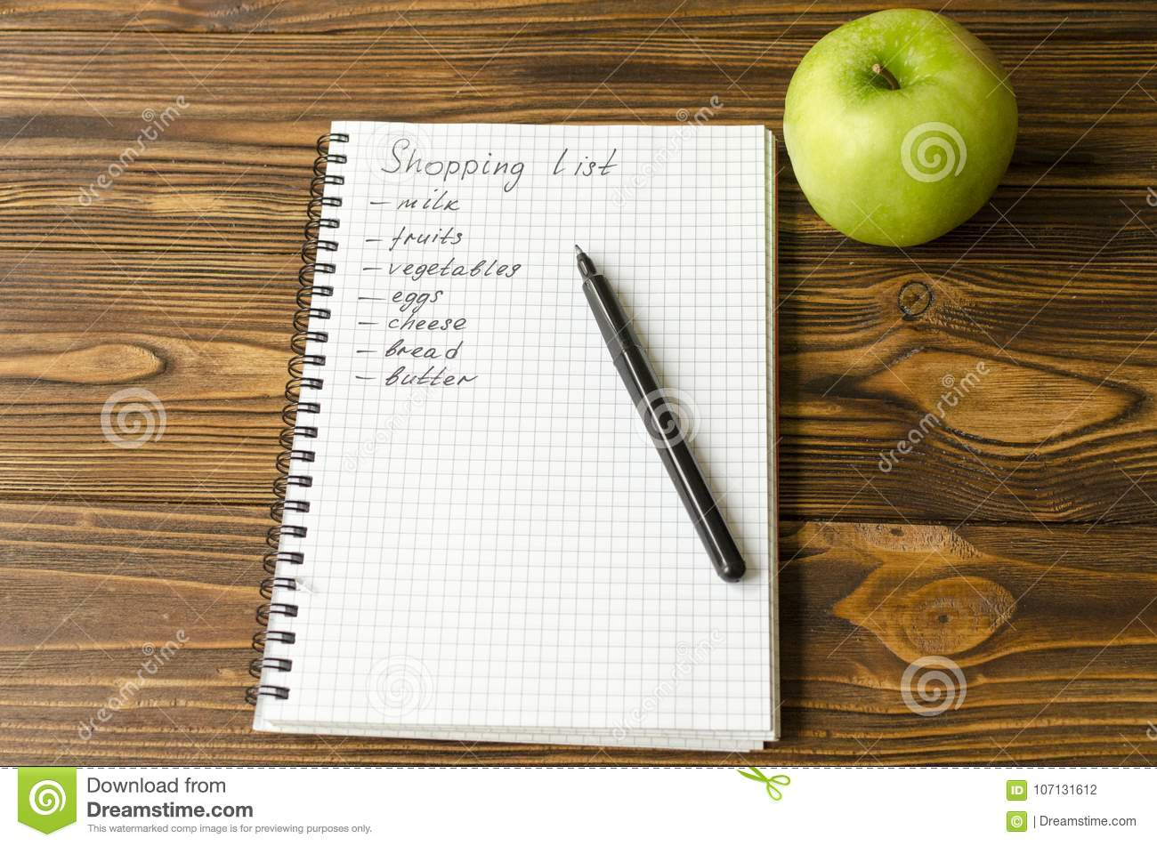 preparing the shopping list before going to buy the groceries stock