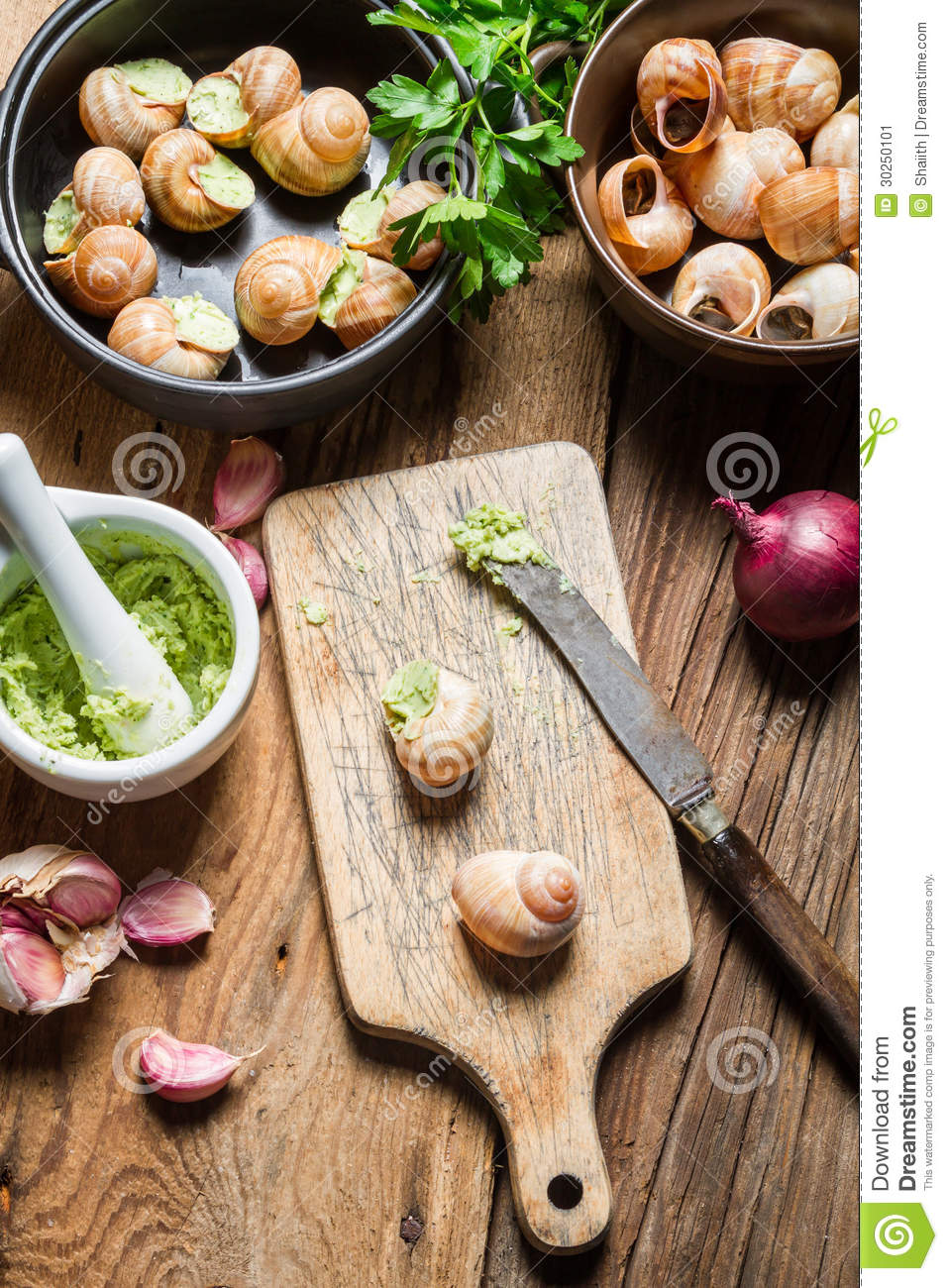 Preparing Snails With Garlic Butter And Herbs Stock Image ...