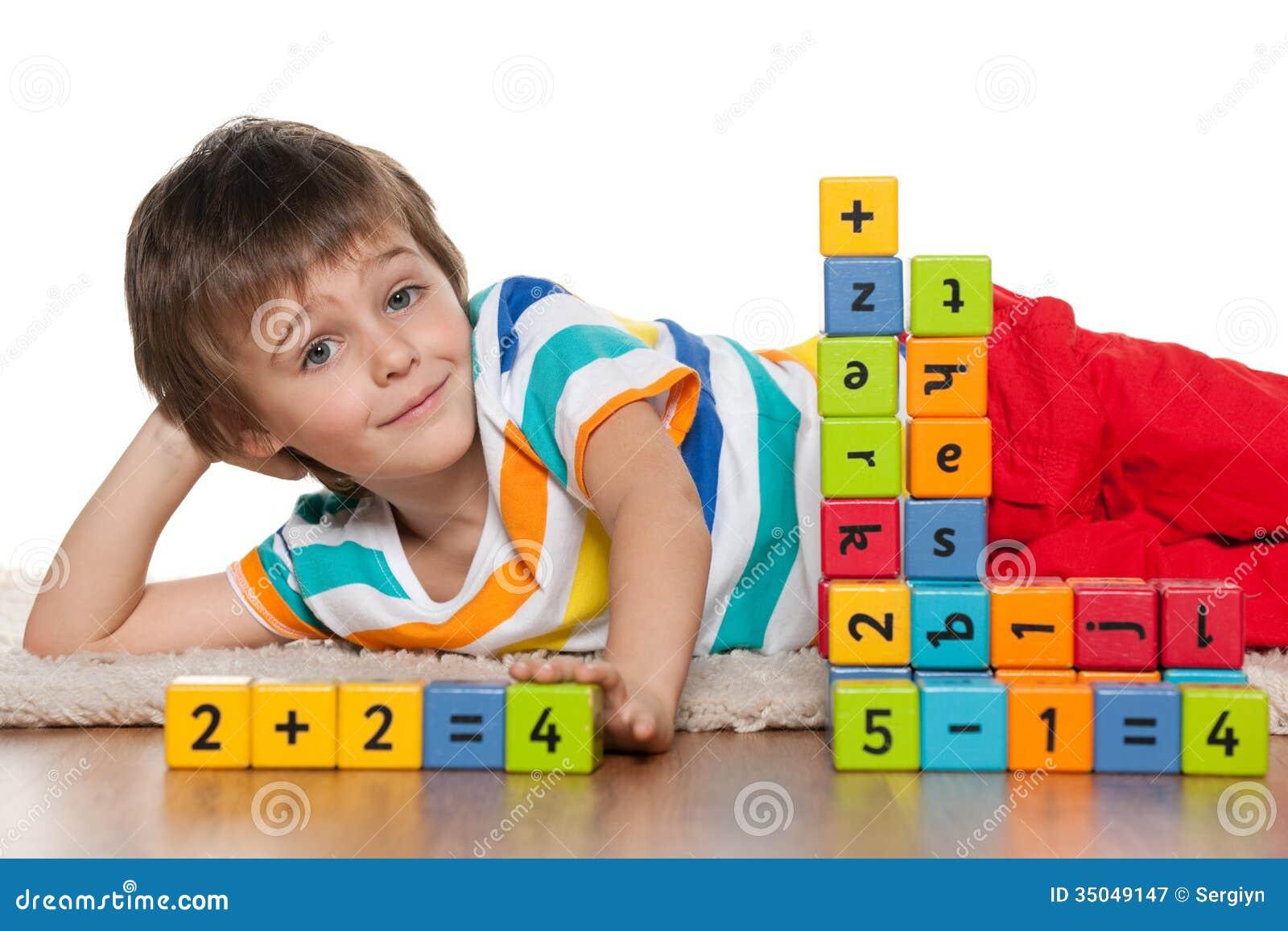 Preschool boy with blocks on the floor
