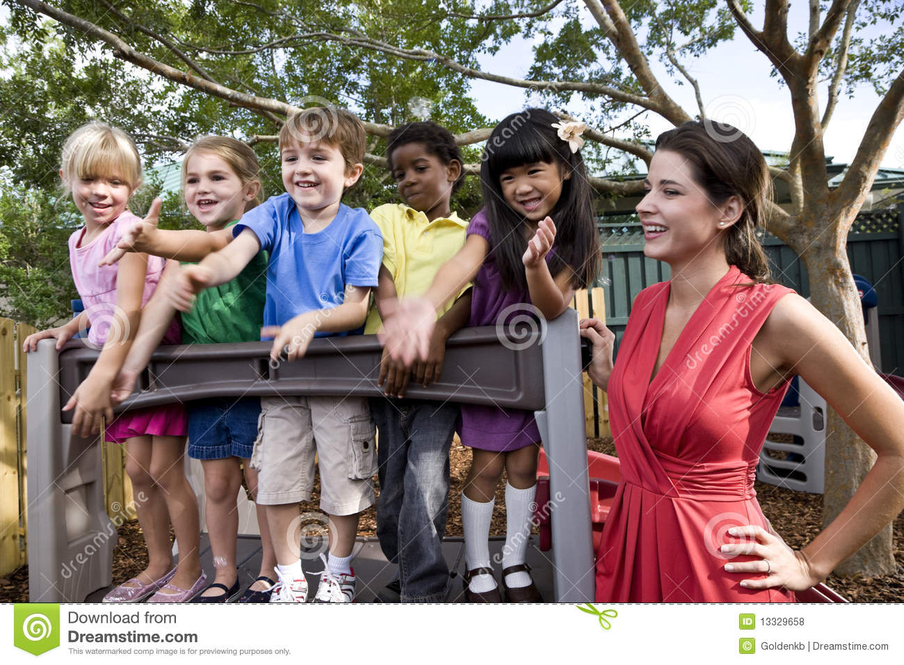 Preschool Children On Playground With Teacher Stock Photo ...