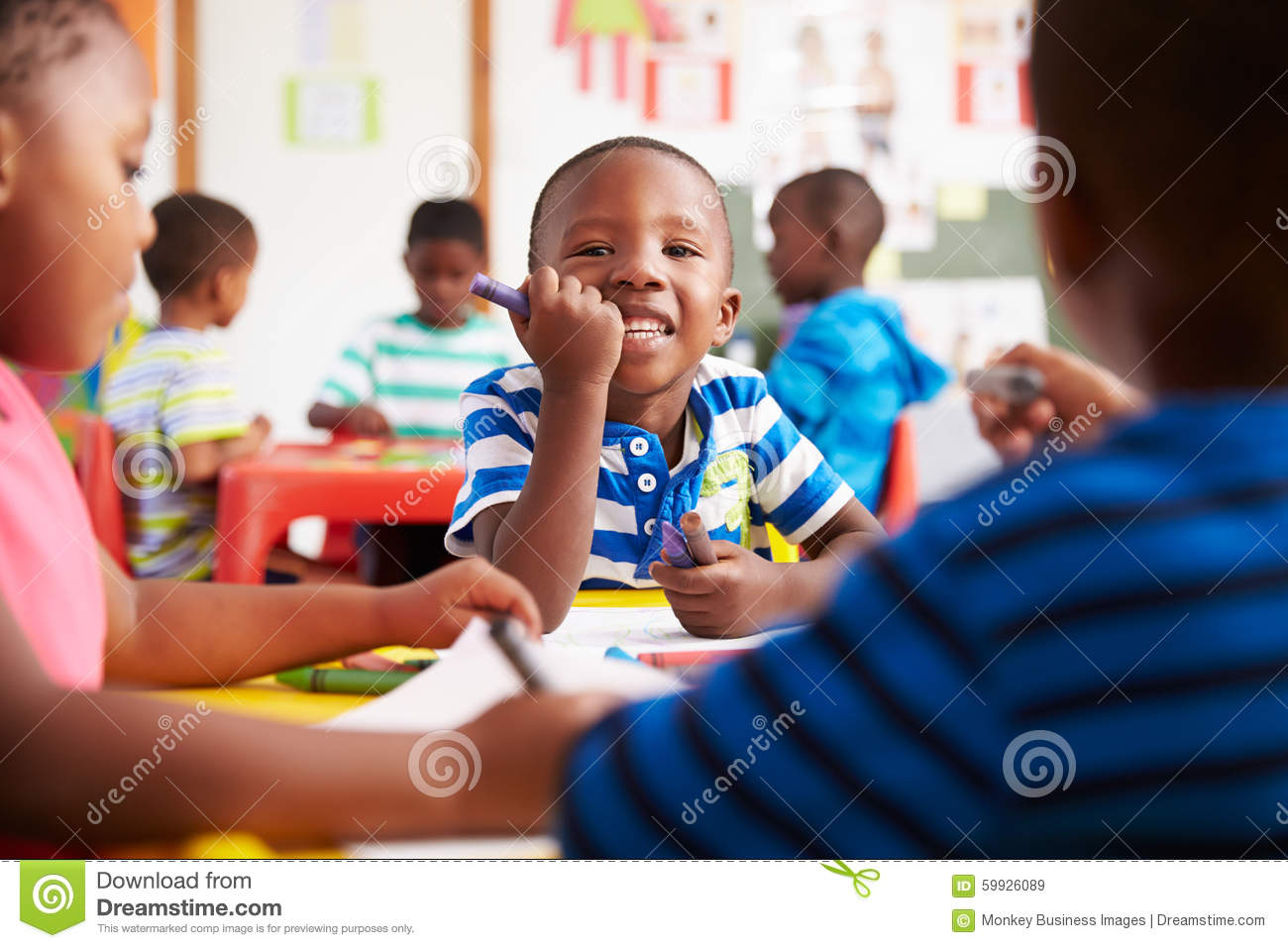 Preschool class in South Africa, boy looking to camera