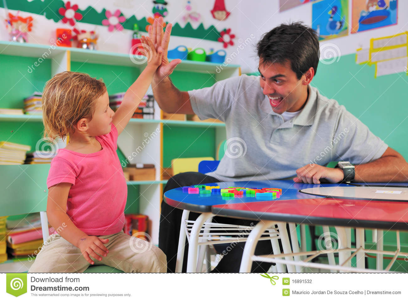 Preschool Teacher And Child Giving High-five Stock Photography - Image ...