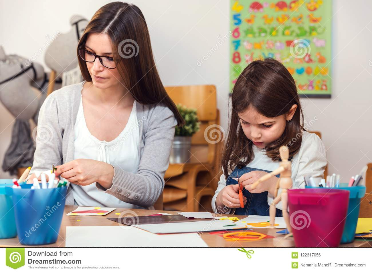 Preschool teacher with child at Kindergarten - Creative Art Class