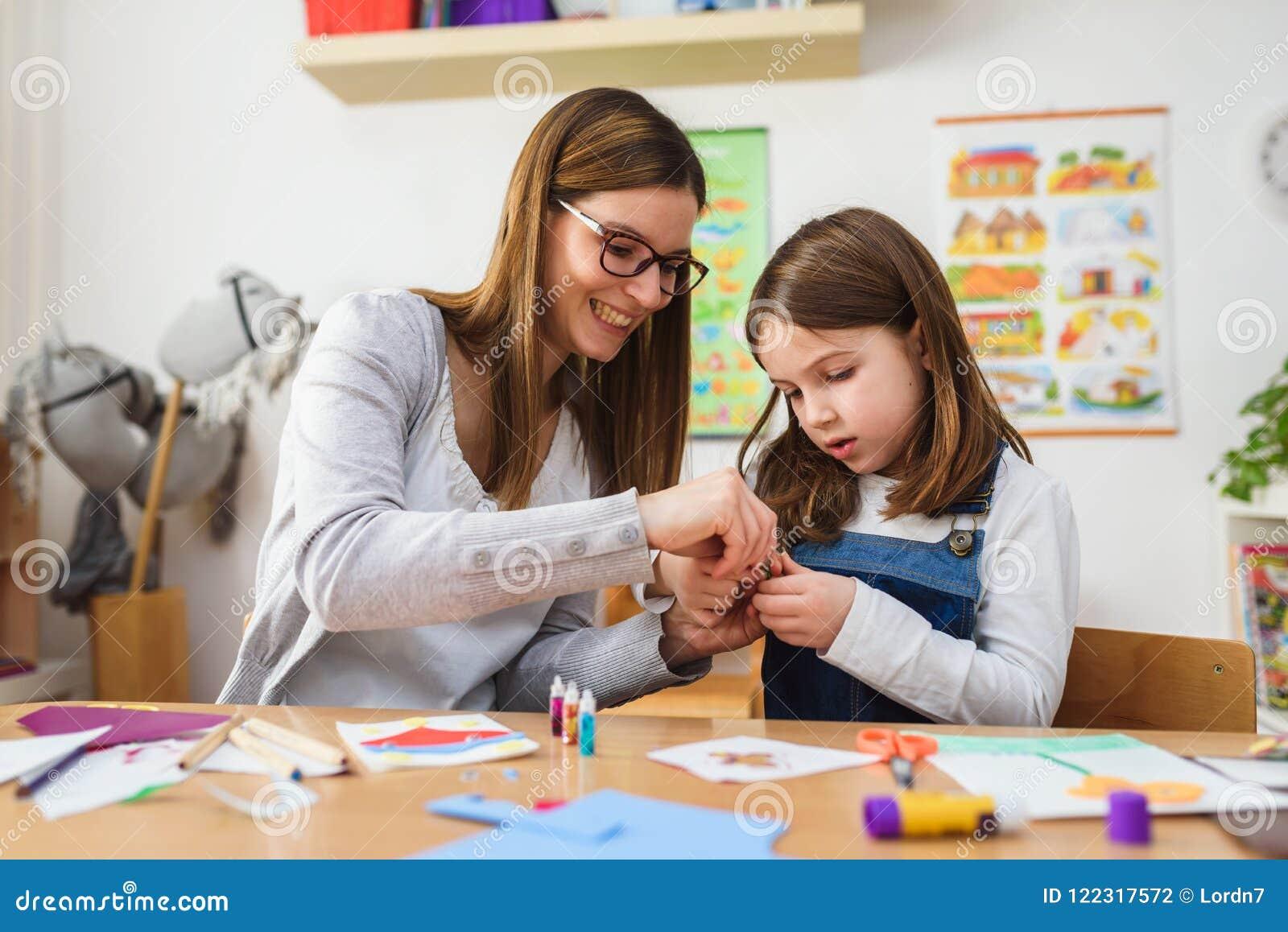 Preschool teacher with child at Kindergarten - Creative Art Class