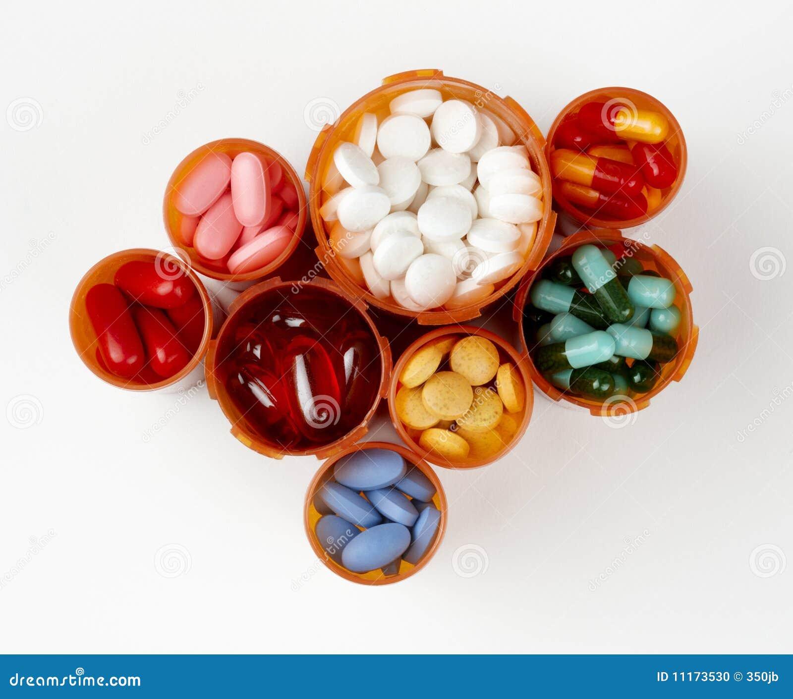 Prescription bottles filled with colorful medicati
