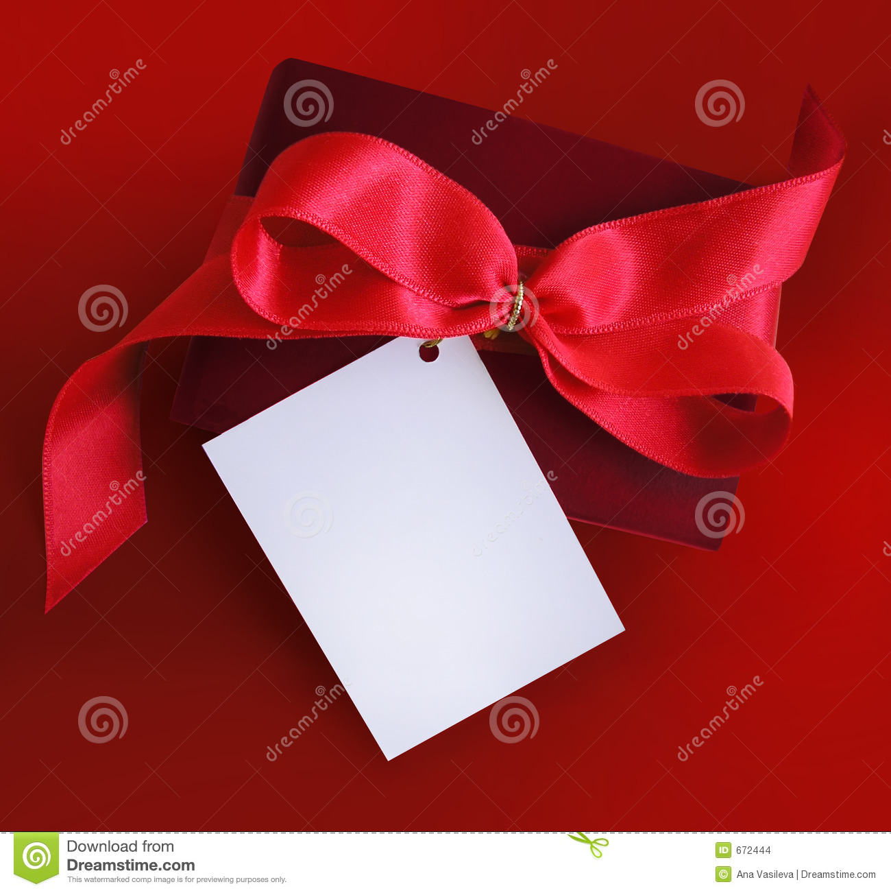 Present with red ribbon and card.