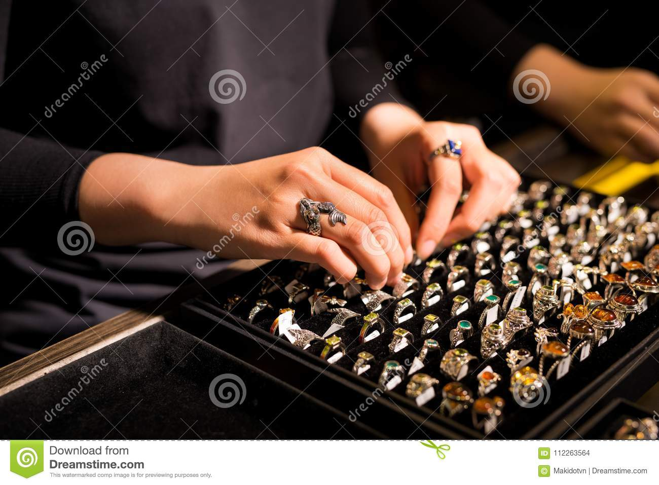 Presentation of retail showcase in jewellery store with rings