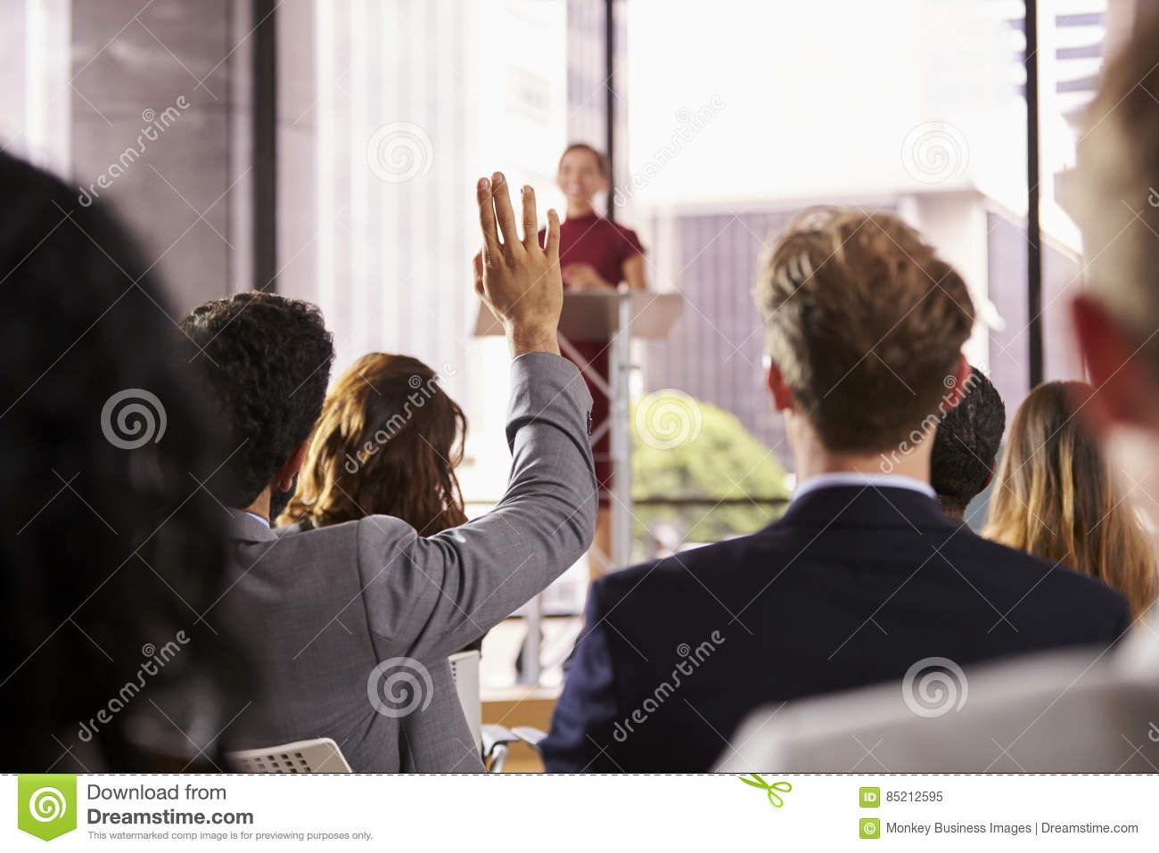 Presenter at business seminar takes a question from audience