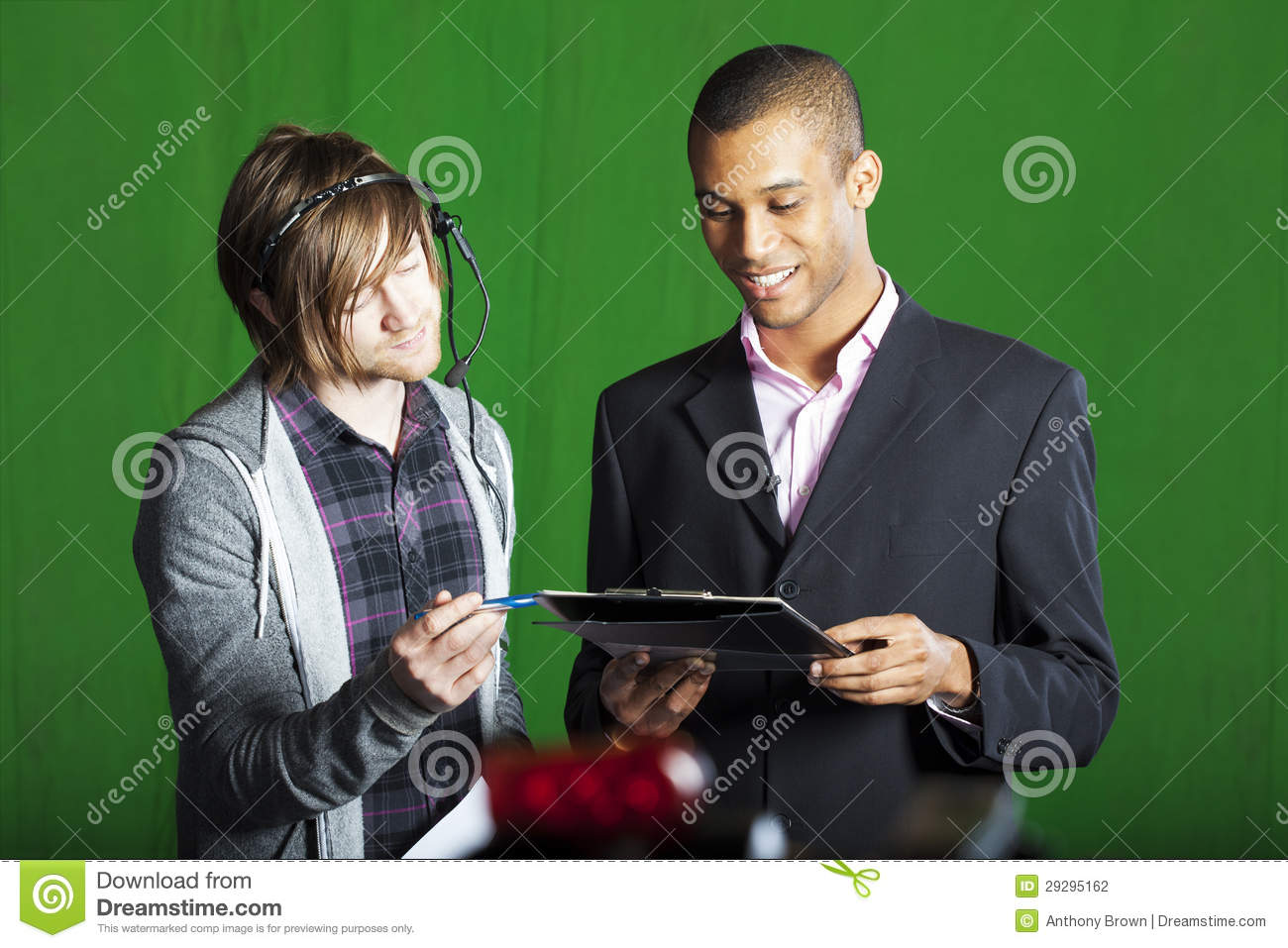 Presenter And Floor Manager In Tv Studio Stock Photography