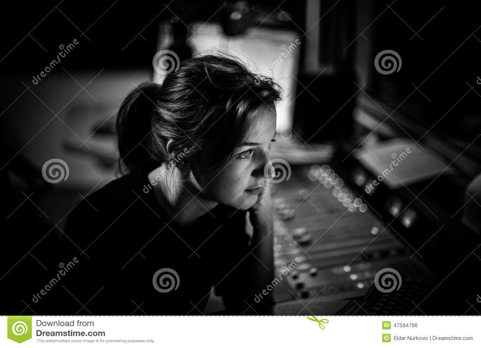 Presenter or host in radio station hosting show for radio live in Studio. Female radio director in studio. Radio producer woman
