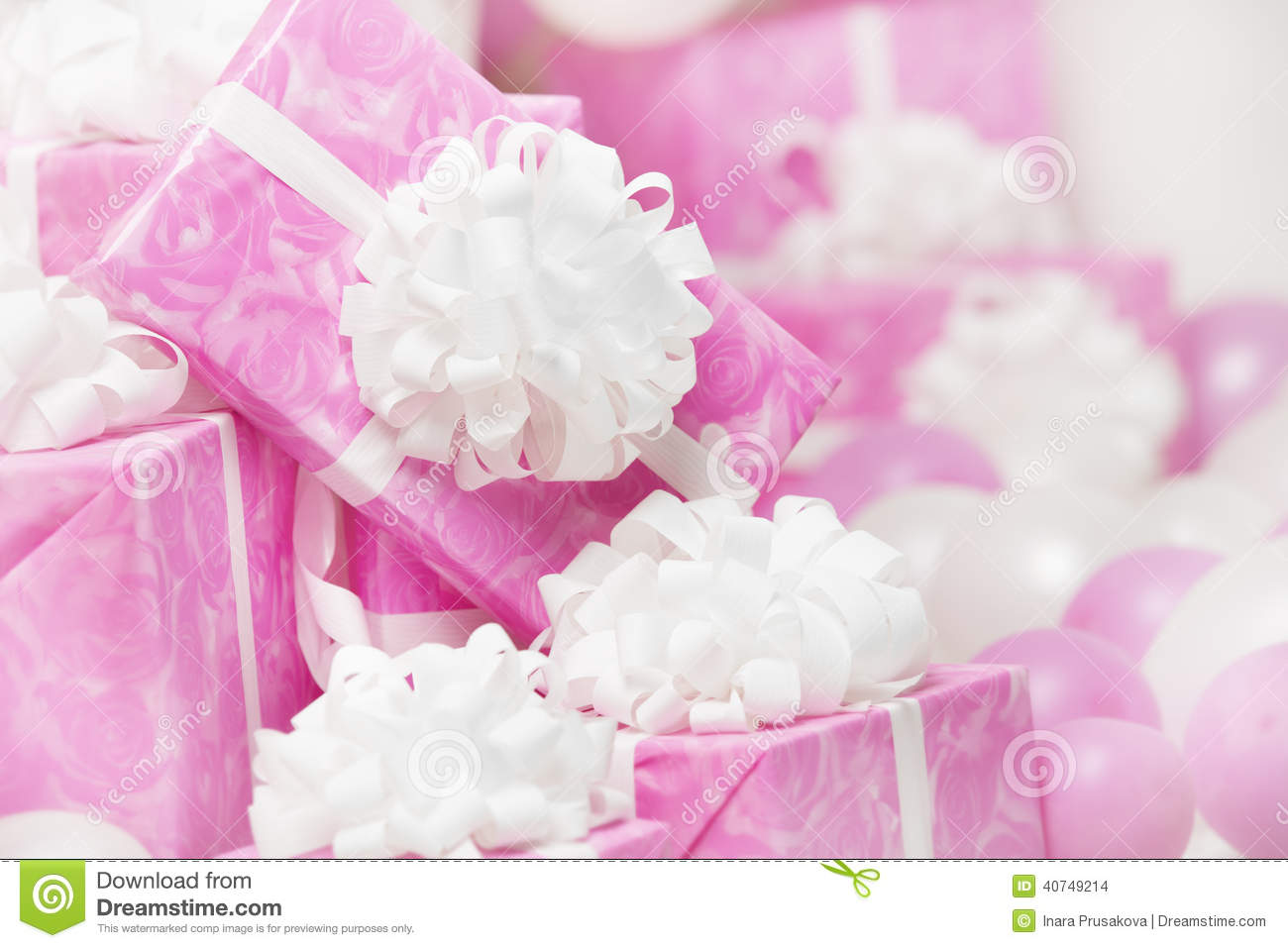 presents gift boxes pink background for female or woman birthda