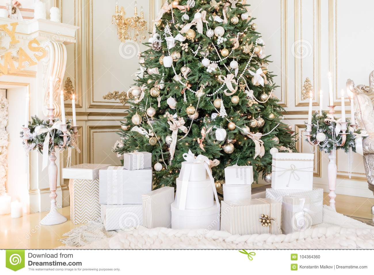 Presents under Christmas Tree in living room. Family Holiday New Year at Home