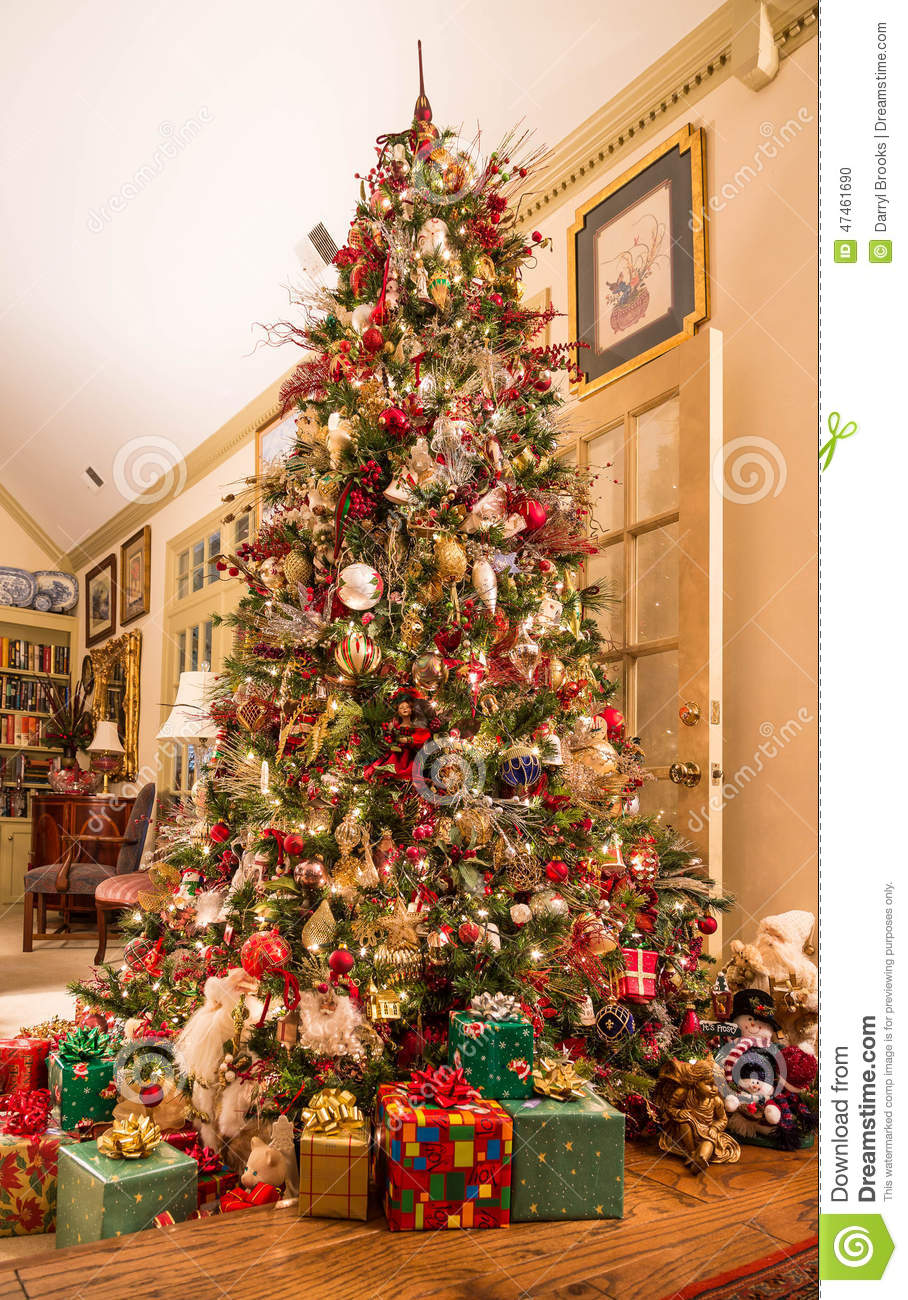 Presents Under Decorated Christmas Tree In Den Stock Photo