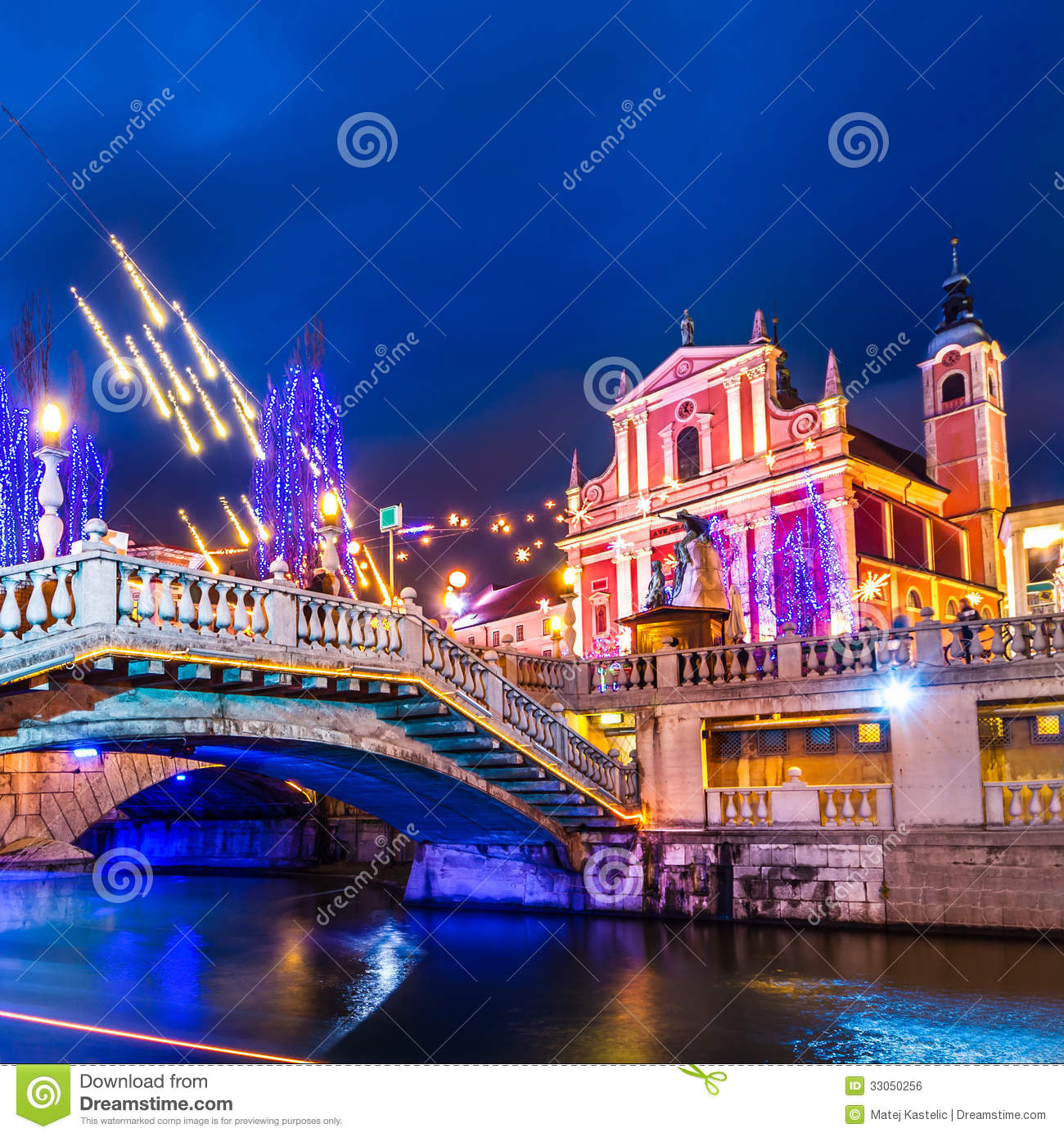 ... city center decorated for Christmas time. River Ljubljanica, Triple